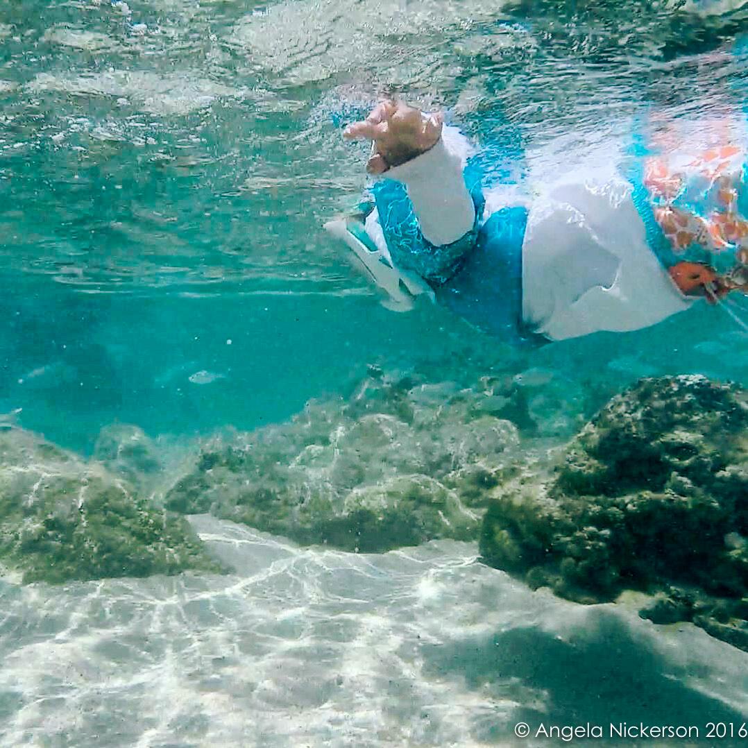 Bambino snorkeling in Oahu, Hawaii
