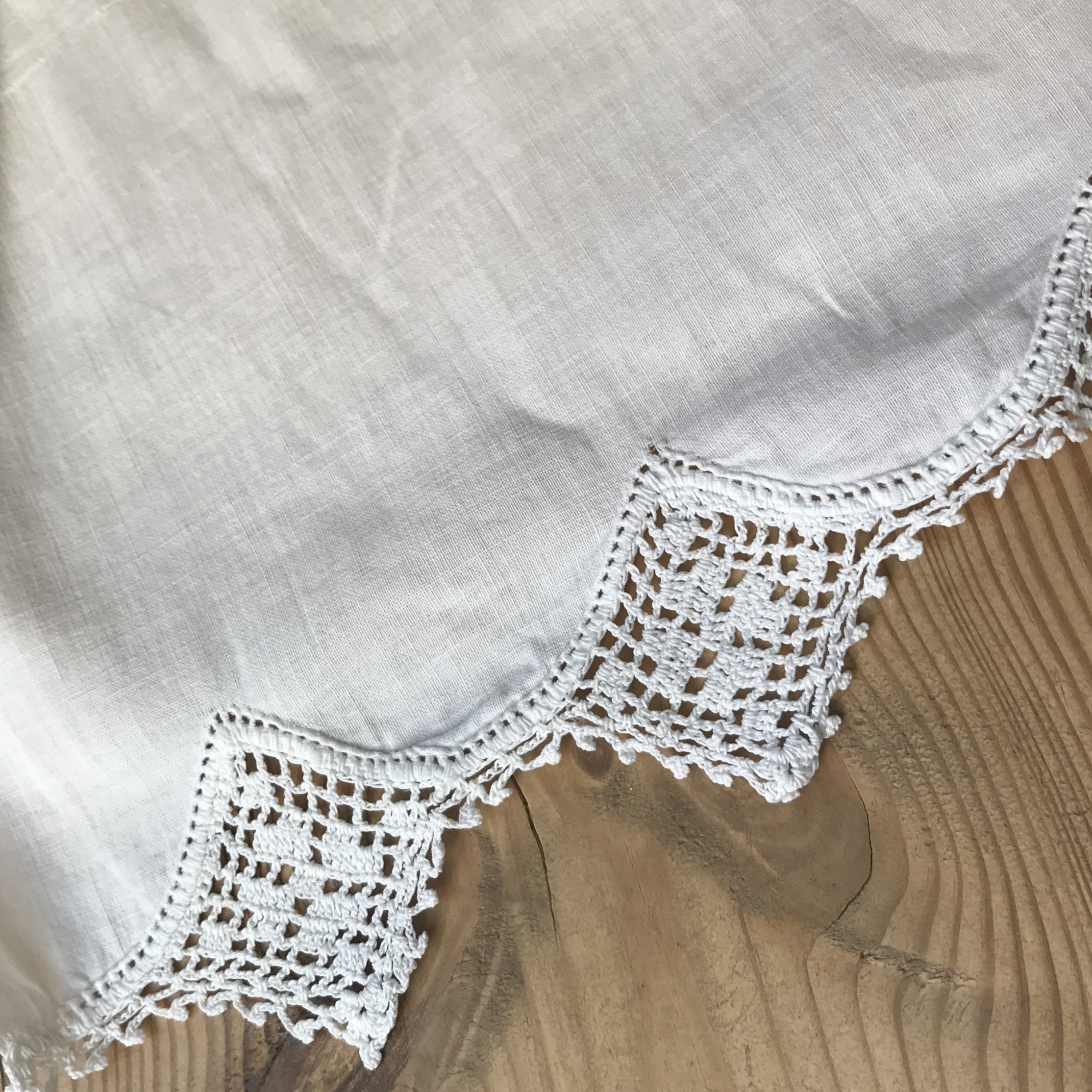 The other sheet has a scalloped edge with handmade lace. It was sheet was so yellow that I thought it was ecru until I laundered it.