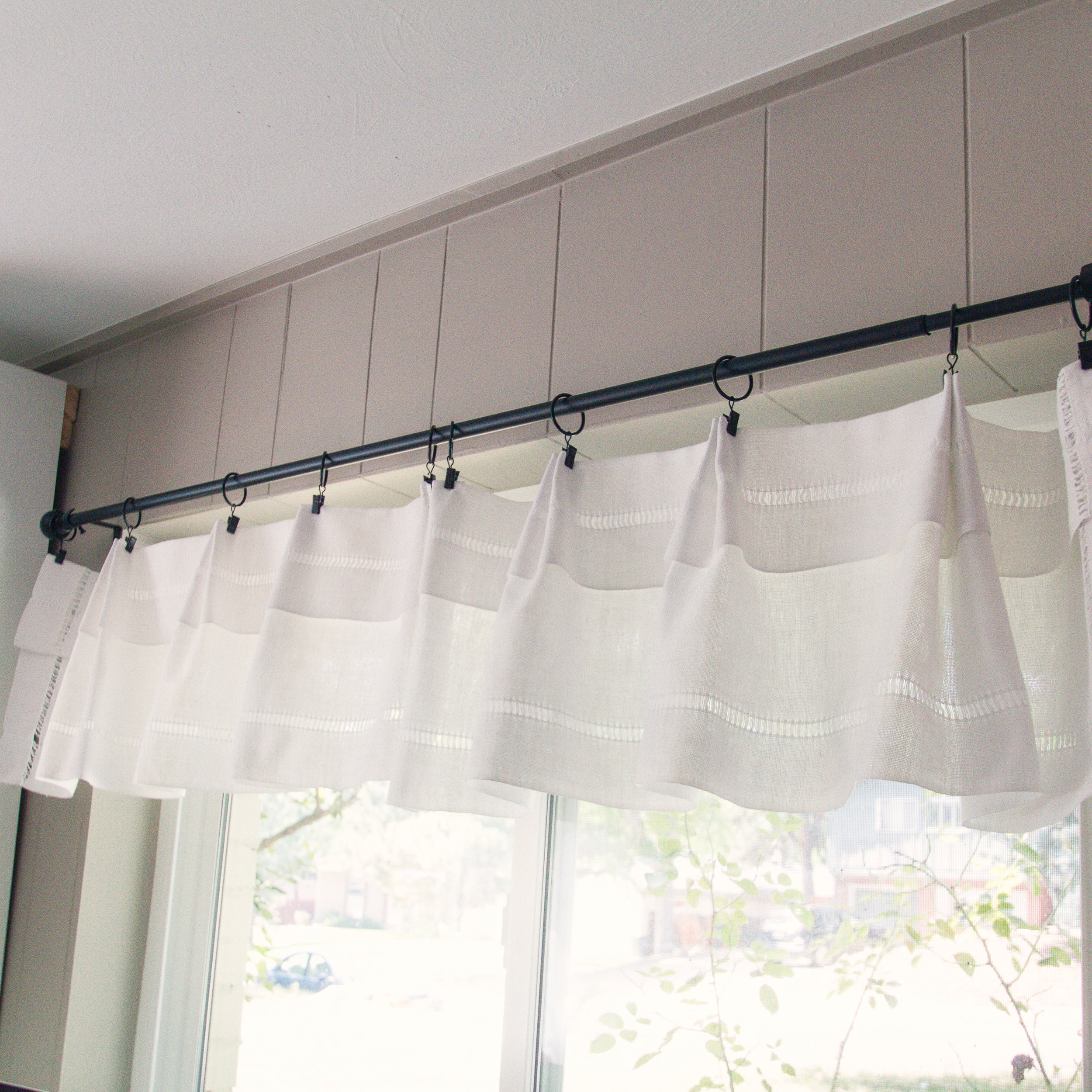 The finished valance over the smaller window.