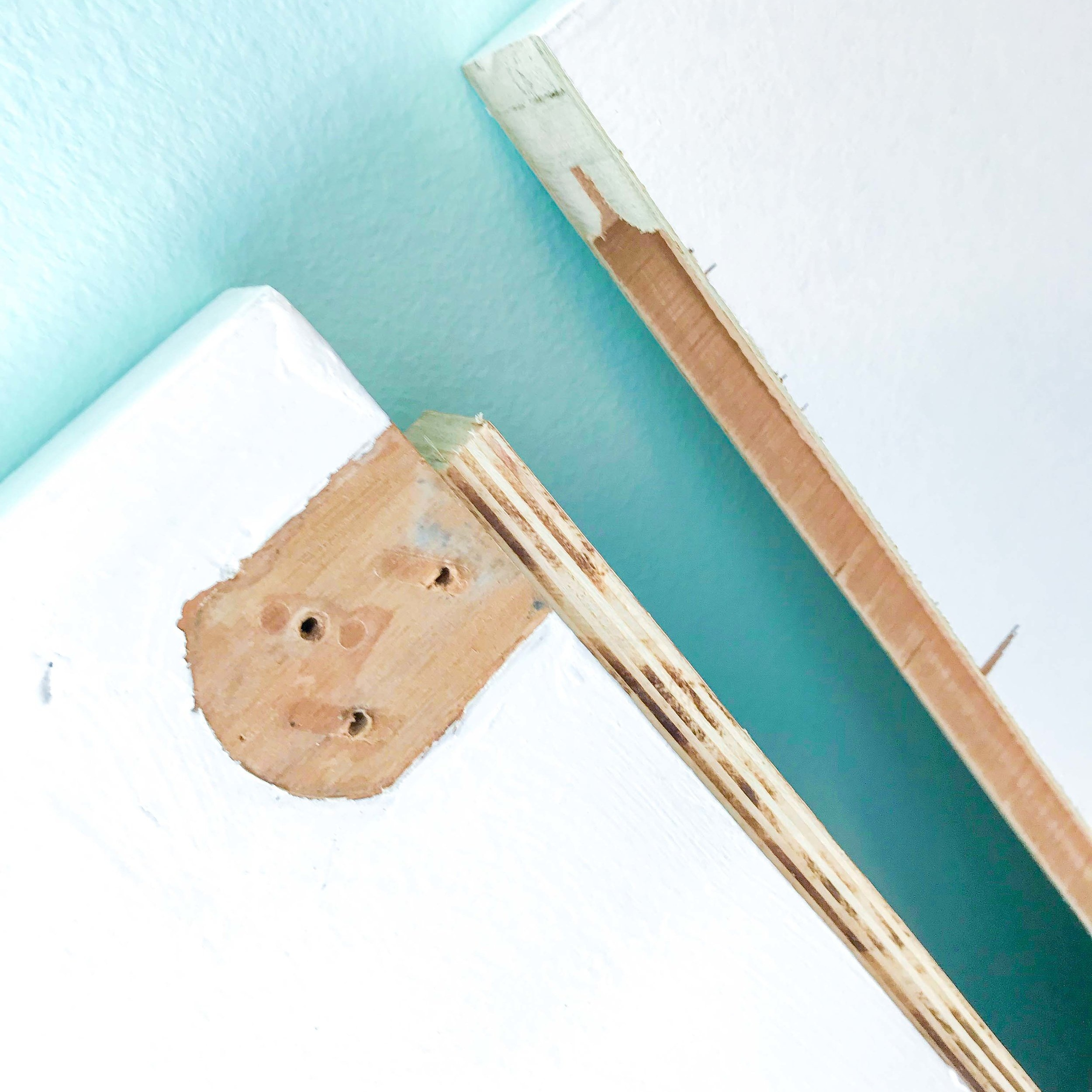 4. Fit the piece of wood into the door cavity.