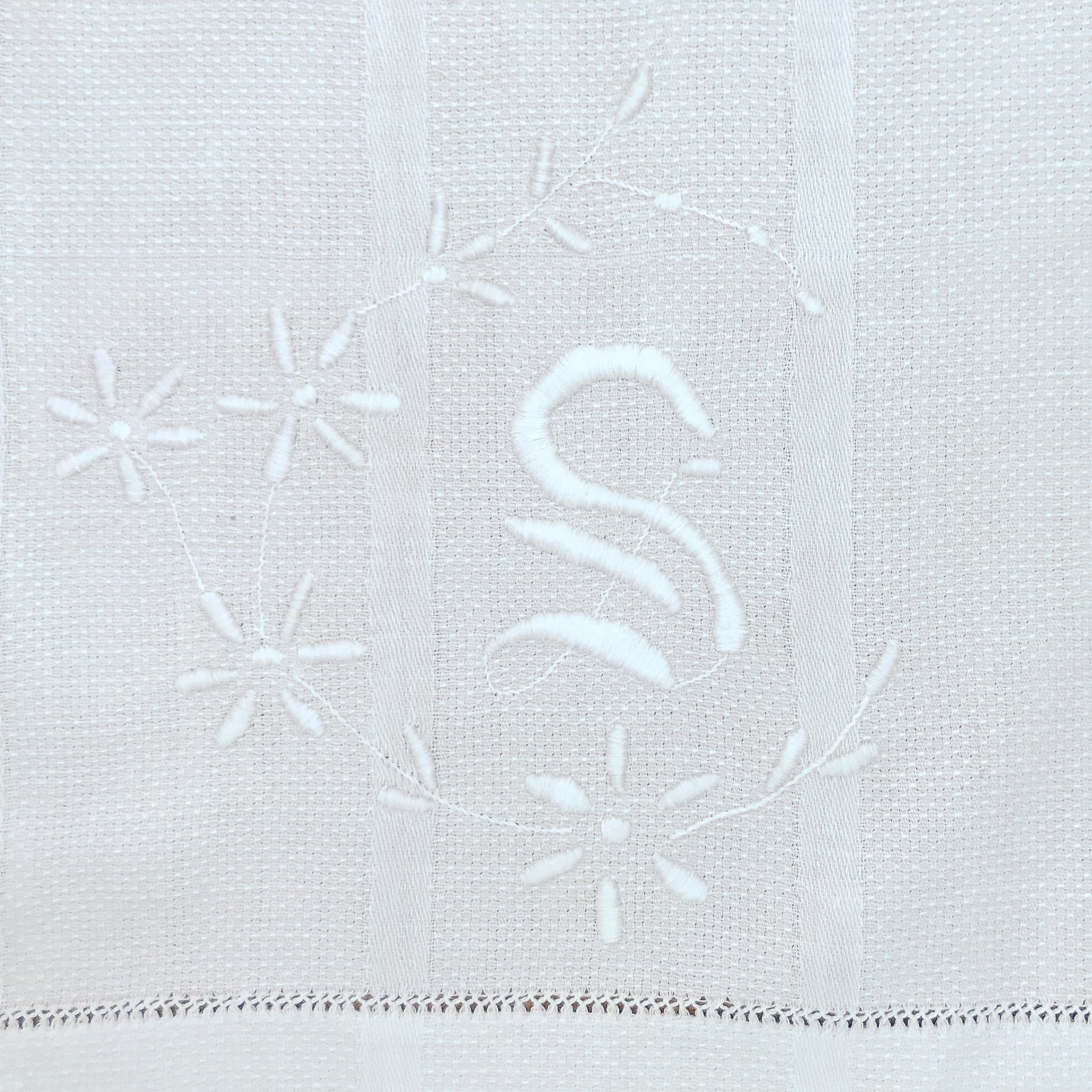 Hand-embroidered monogram on the towel-now-dresser scarf.