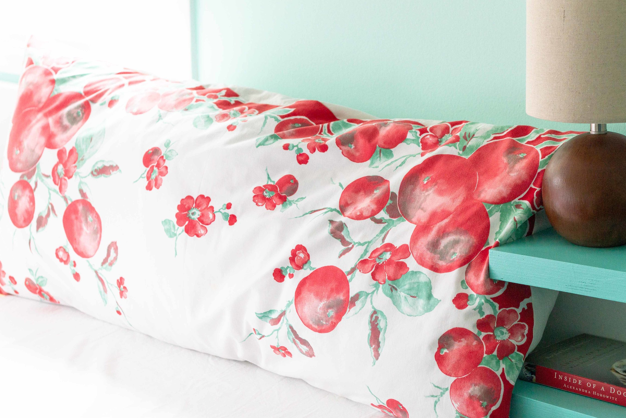 An oversized pillow sham made from a vintage tablecloth.
