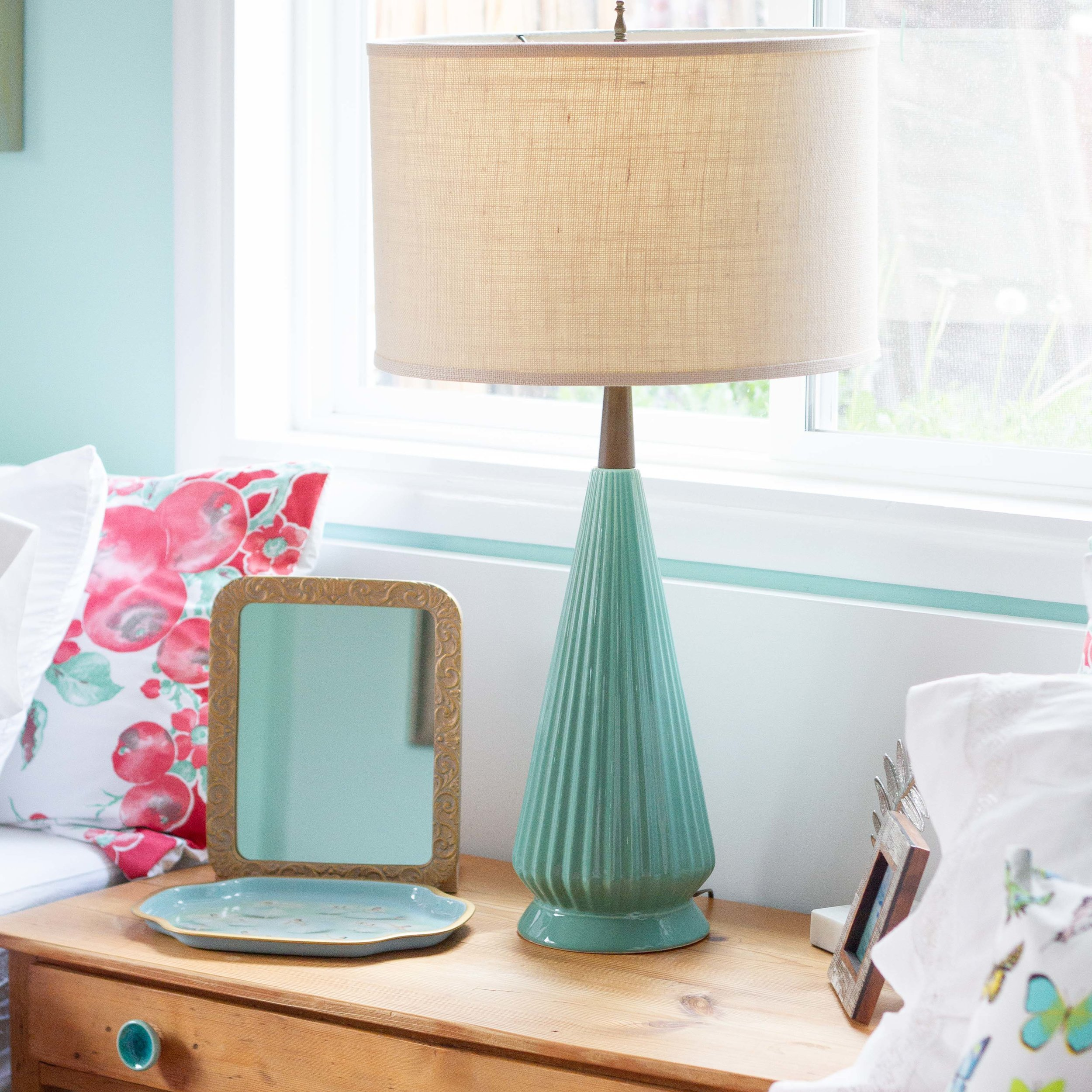 A Craigslist find, this Mid Century lamp just needed new wiring and a shade. The color is perfect in the room.