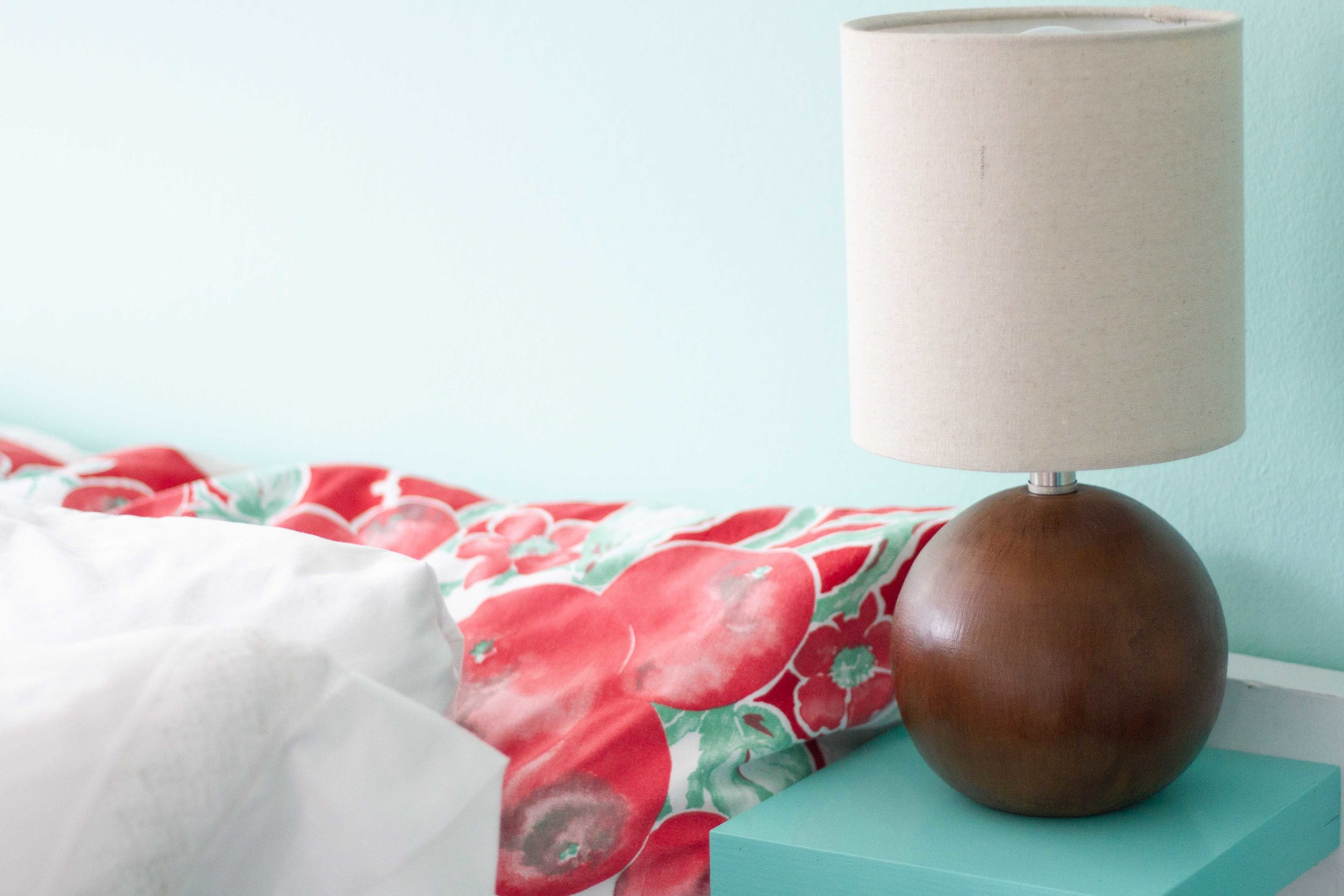 Inexpensive lamps from Target flank each bed.