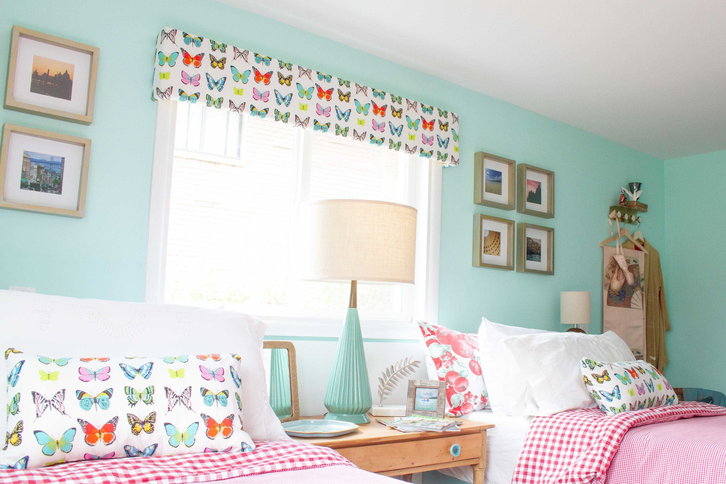 These easy, DIY valances were made from scrap lumber and fabric specifically chosen for this room.