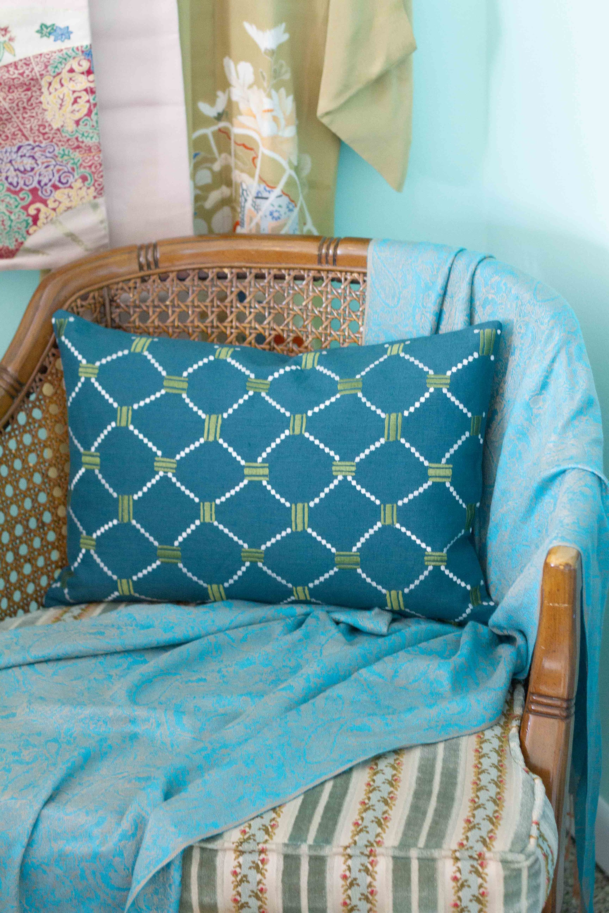 This pillow is the perfect size and shape for this vintage chair.