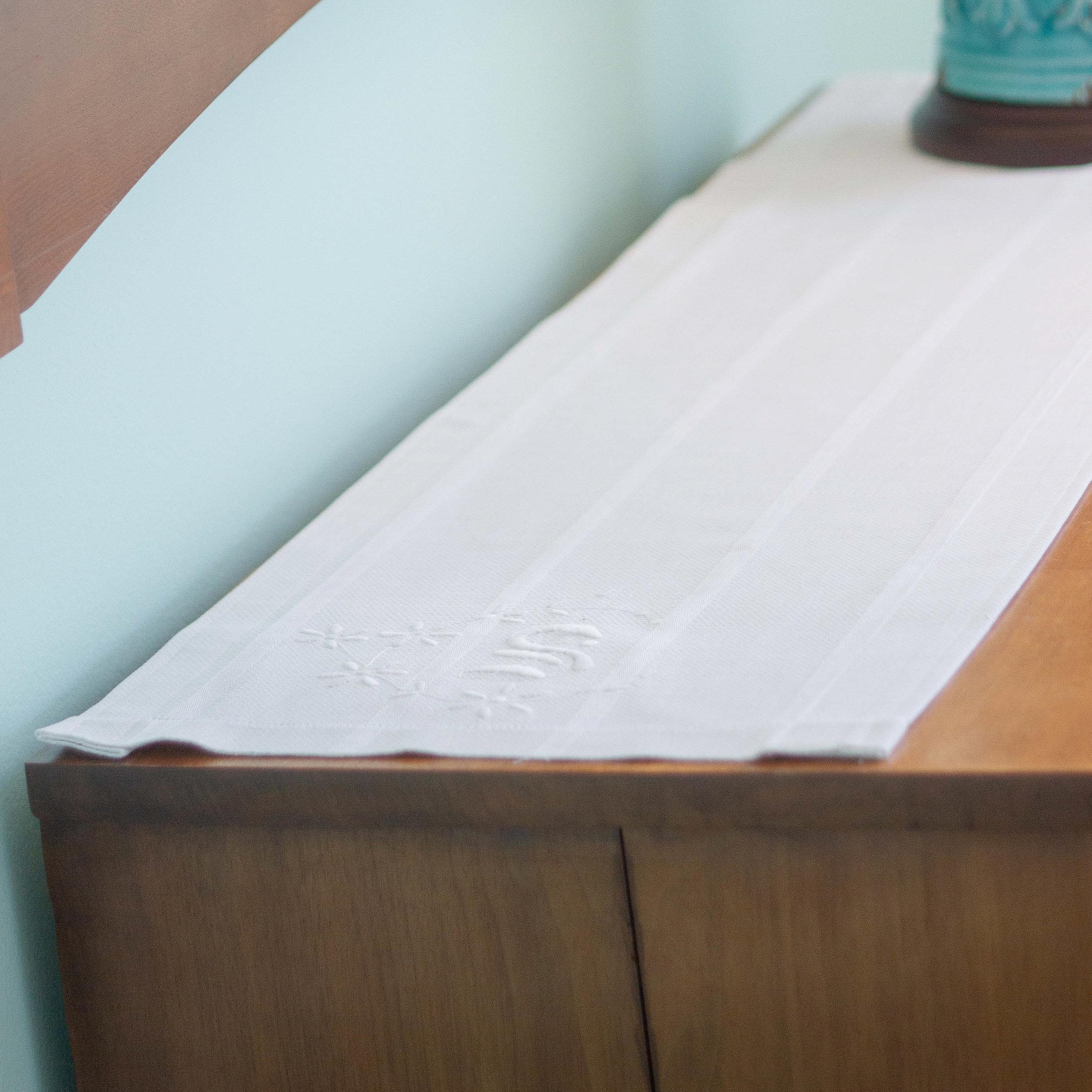 A vintage towel, hand monogrammed, became the dresser scarf.