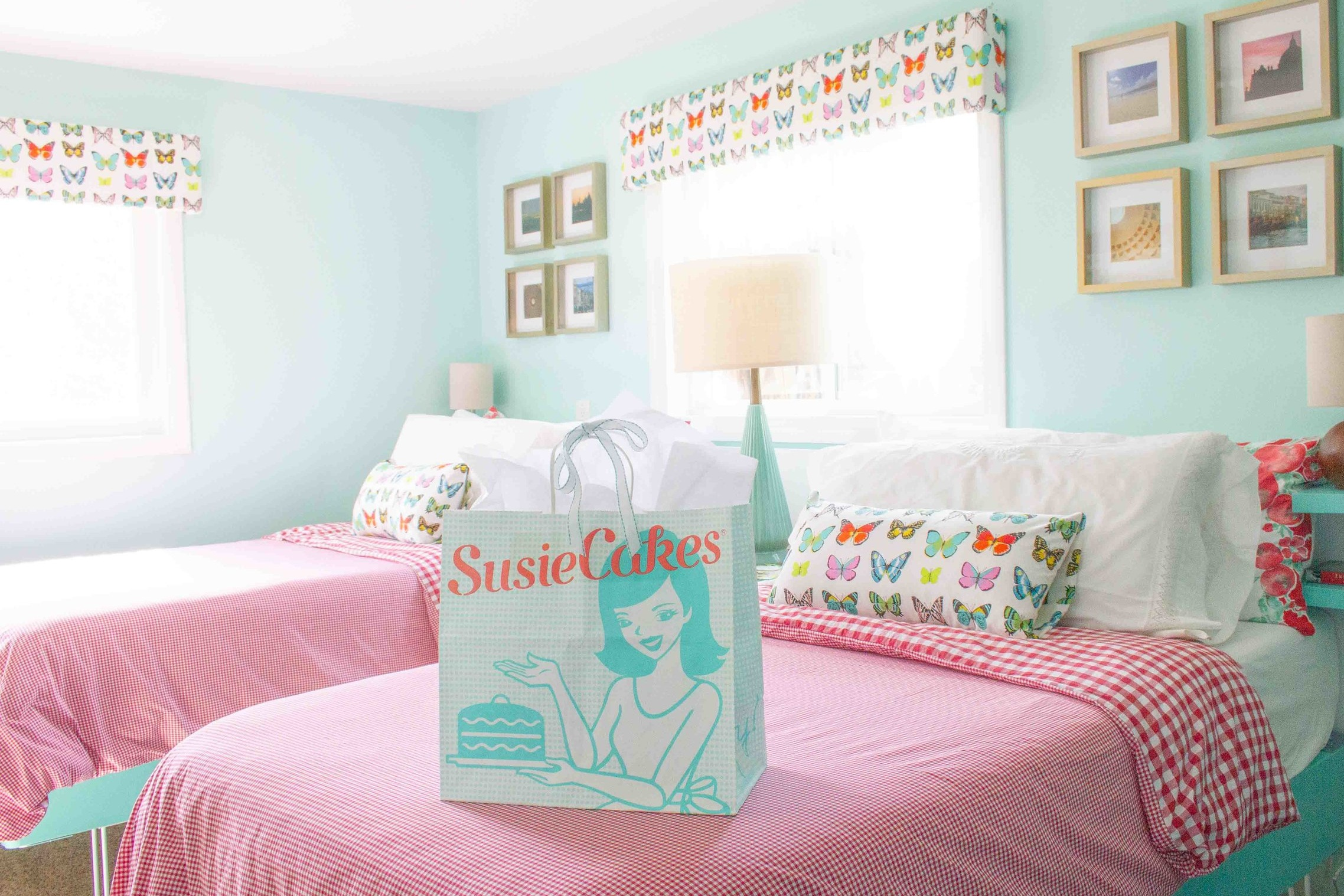 """When I described my vision for a retro-inspired room with a red and turquoise color scheme, my husband immediately said, """"Oh, it will look like a  Susie Cakes  bag!"""" What do you think? Hopefully our Guest Room Refresh is as sweet as the treats at our favorite San Francisco bakery!"""