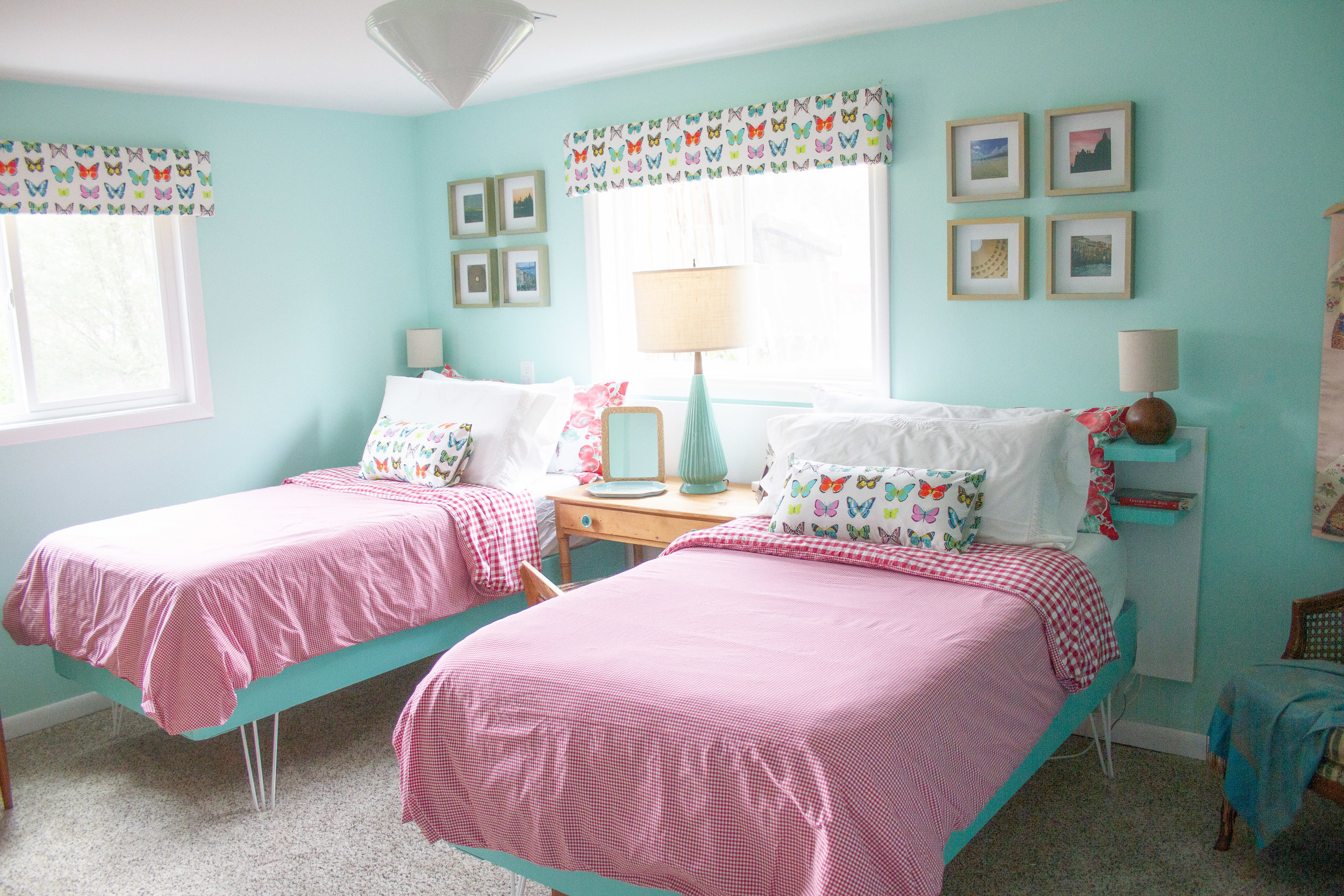 Two twin beds make a guest room more flexible for groups of guests.