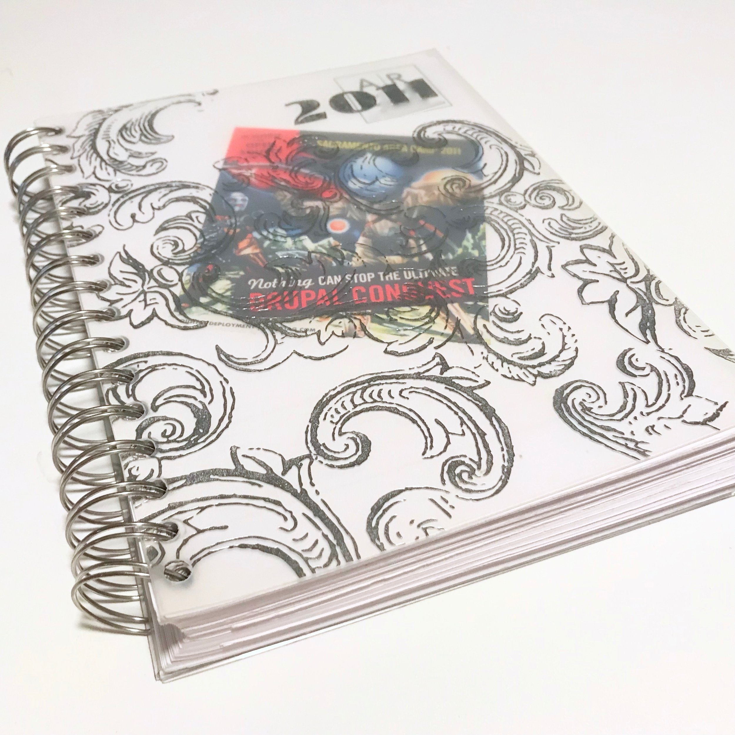 A spiral-bound agenda is an inexpensive planner option.