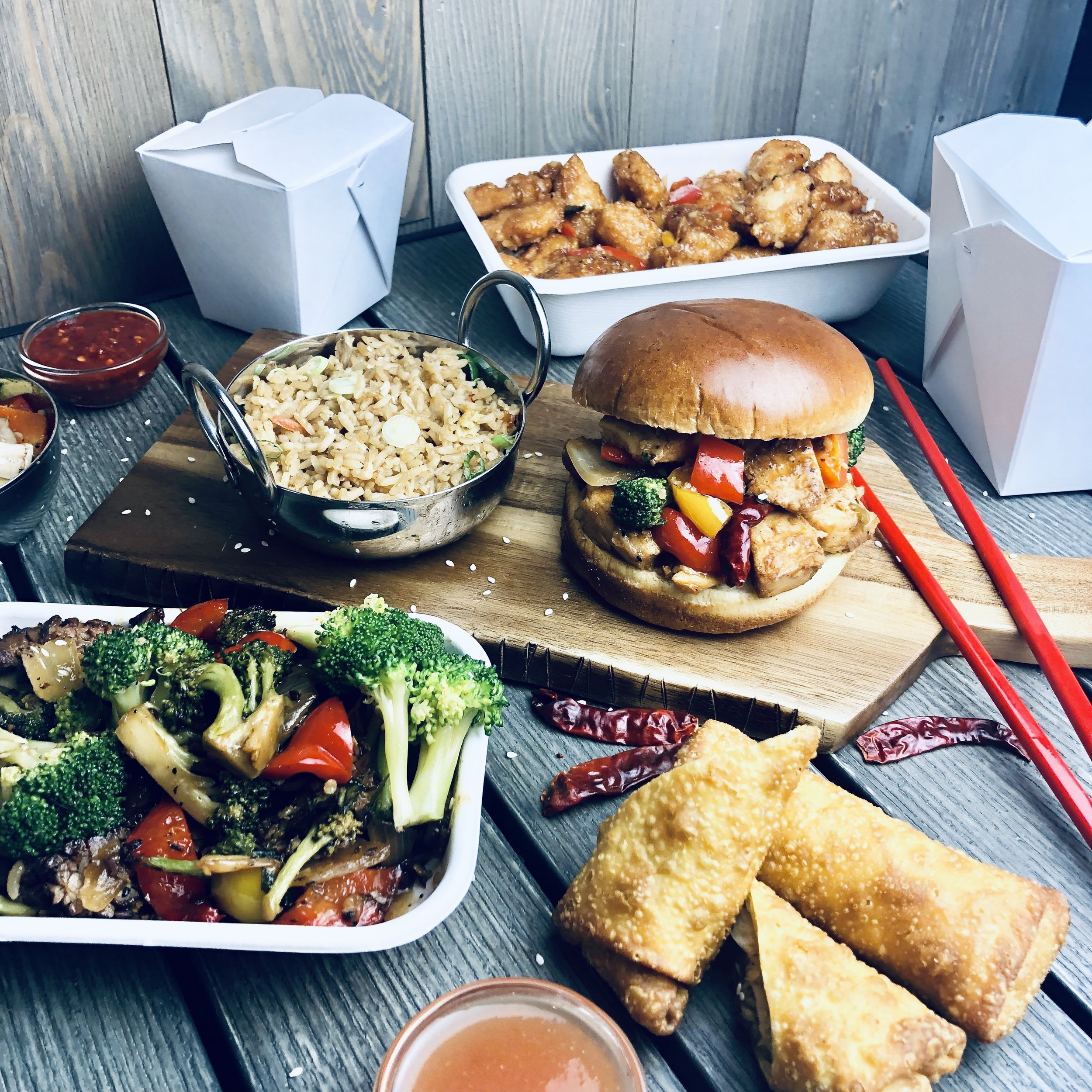 Butcher & the Wok (Food items pictured from top to bottom: Honey Garlic Chicken, Garlic Fried Rice, Beijing Chicken Sandwich, Basil Beef and Short Rib Egg rolls)