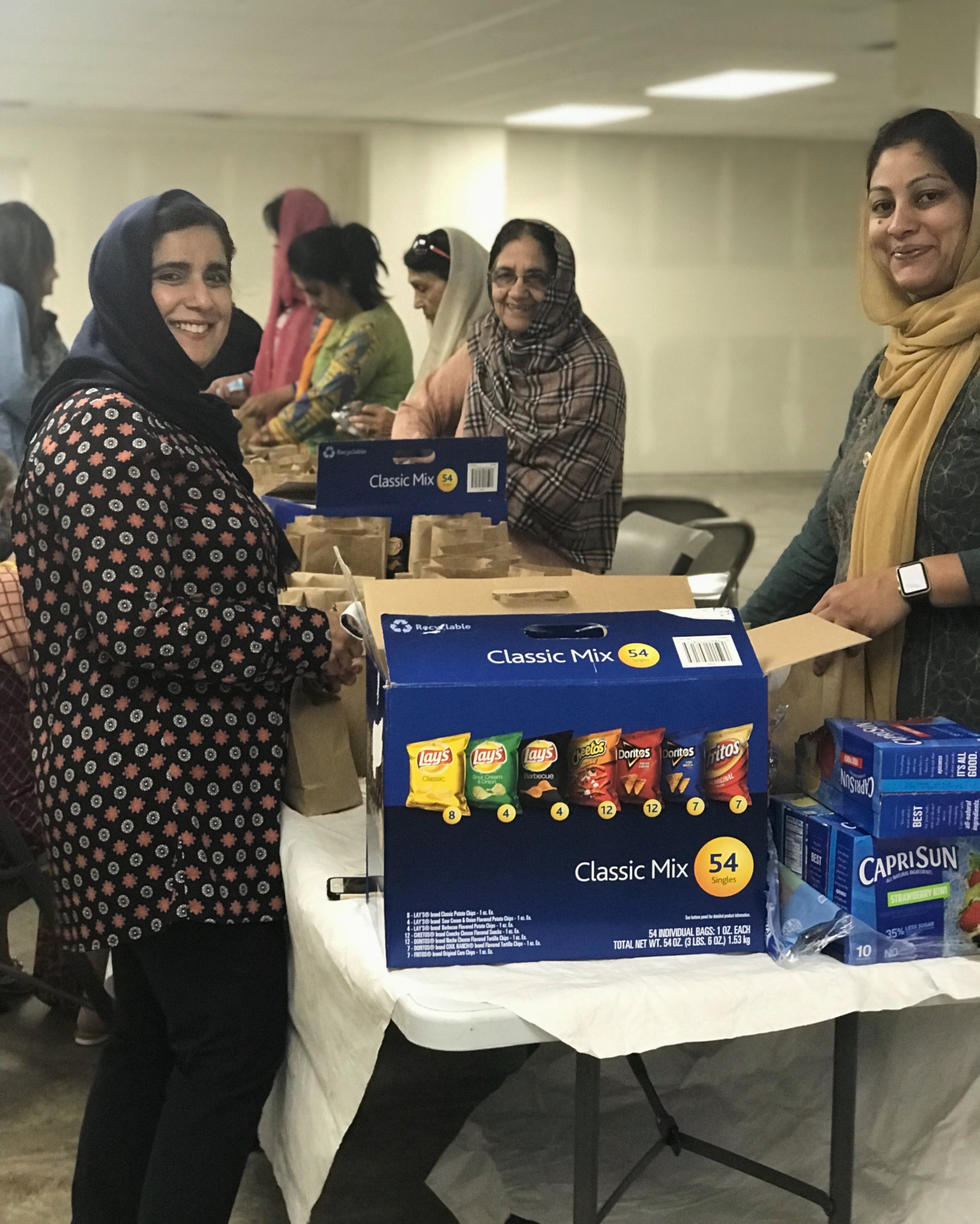 Evergreen Islamic Centre hosting a snack packing event with Rahima Foundation