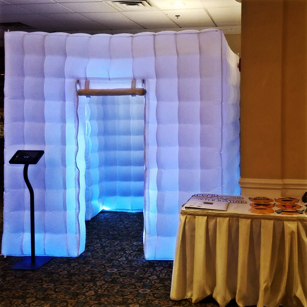 Photo Booths - Make your event picture perfect with an open or enclosed booth, a dedicated attendant, props, customized pic strips, a scrapbook, and digital copies of all of the event's photos, from start to finish!