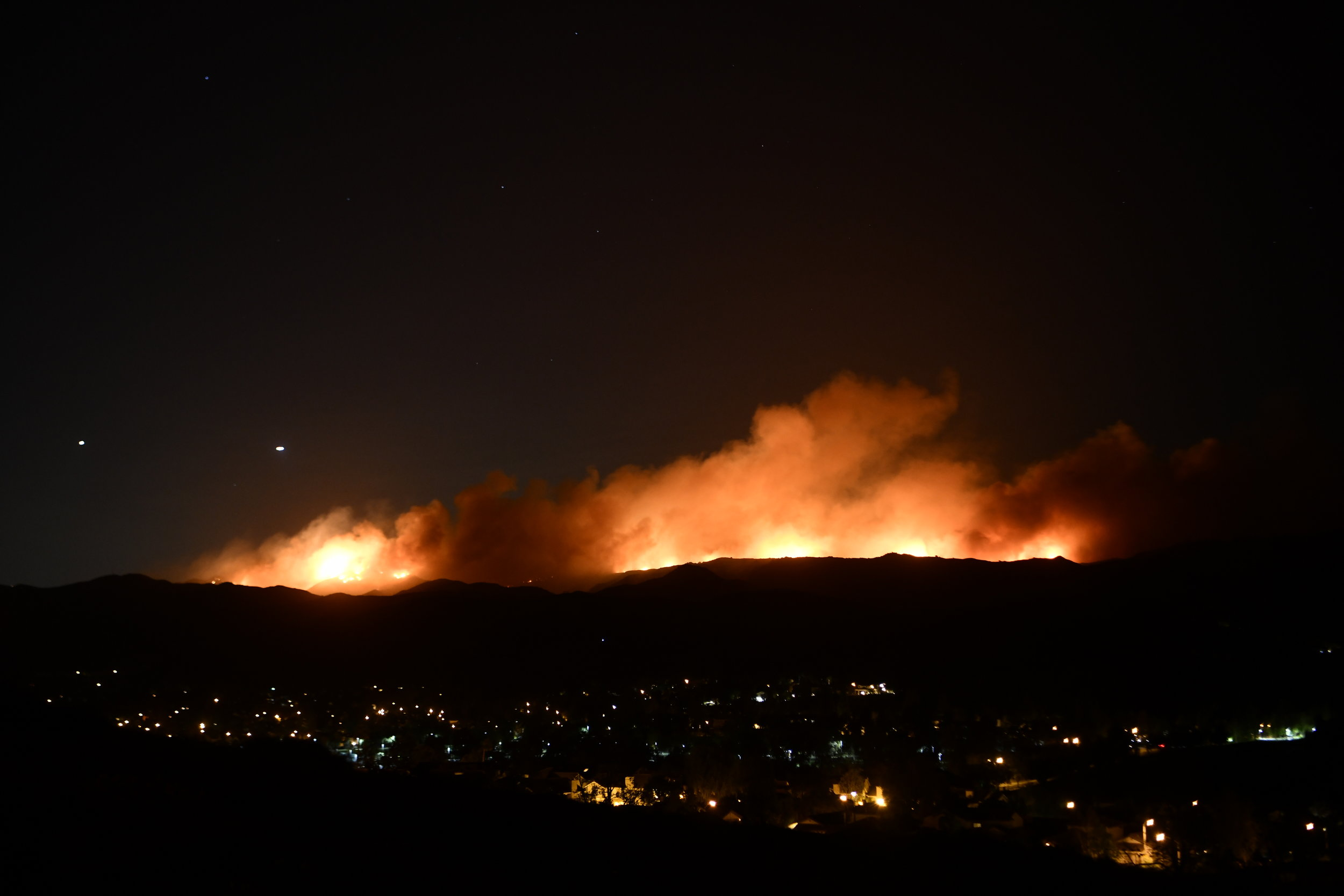 The Woolsey Fire picks up steam and moves toward Oak Park as Santa Ana Winds increase in strength late Thursday evening hours after the fire started. Looking south at the fire from Simi Valley.