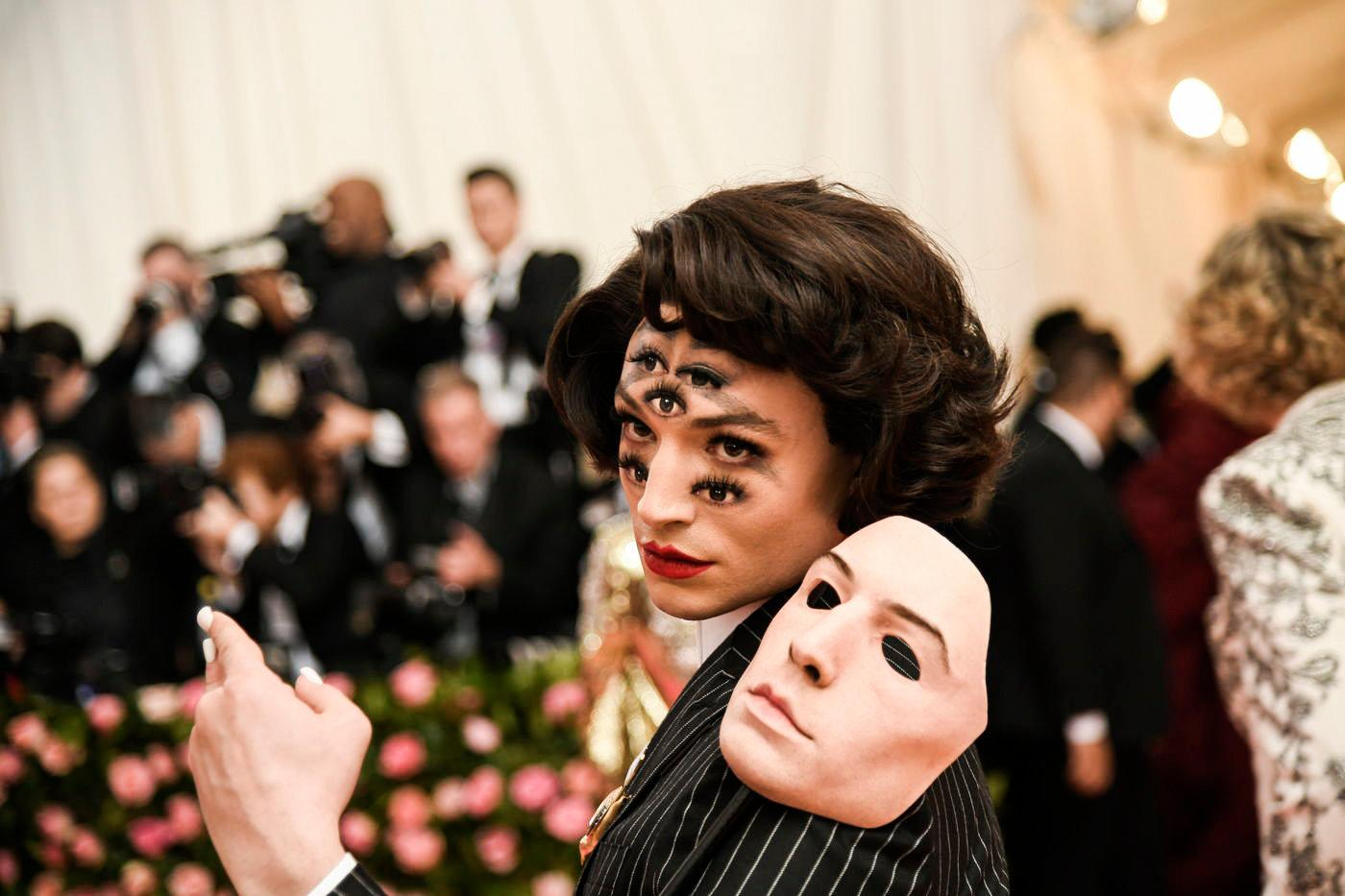 Ezra Miller in trippy-effect make up.