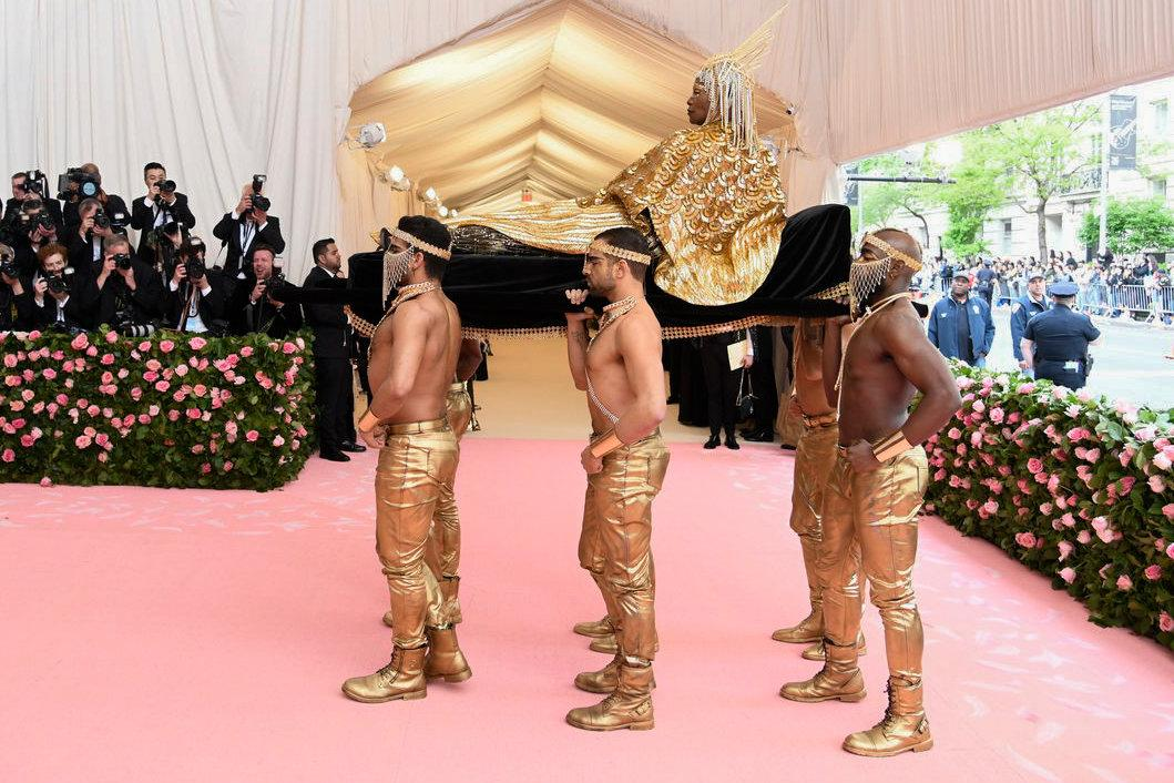 Billy Porter being, transported (transportered??) by shirtless models. As one does.