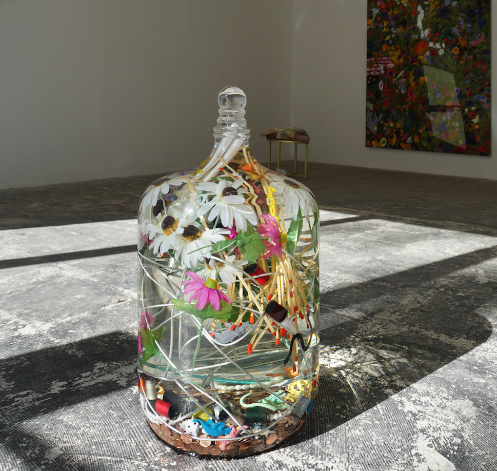 Lazaros,  Spell for abundance , 2018, Glass, mineral oil, matches, 3,333 pennies, steel wire, silk flowers, dice, pearl bracelets, plastic animals, plastic insects, spools of thread, feather, fluorescent bulbs, 21 x 12 x 12 inches