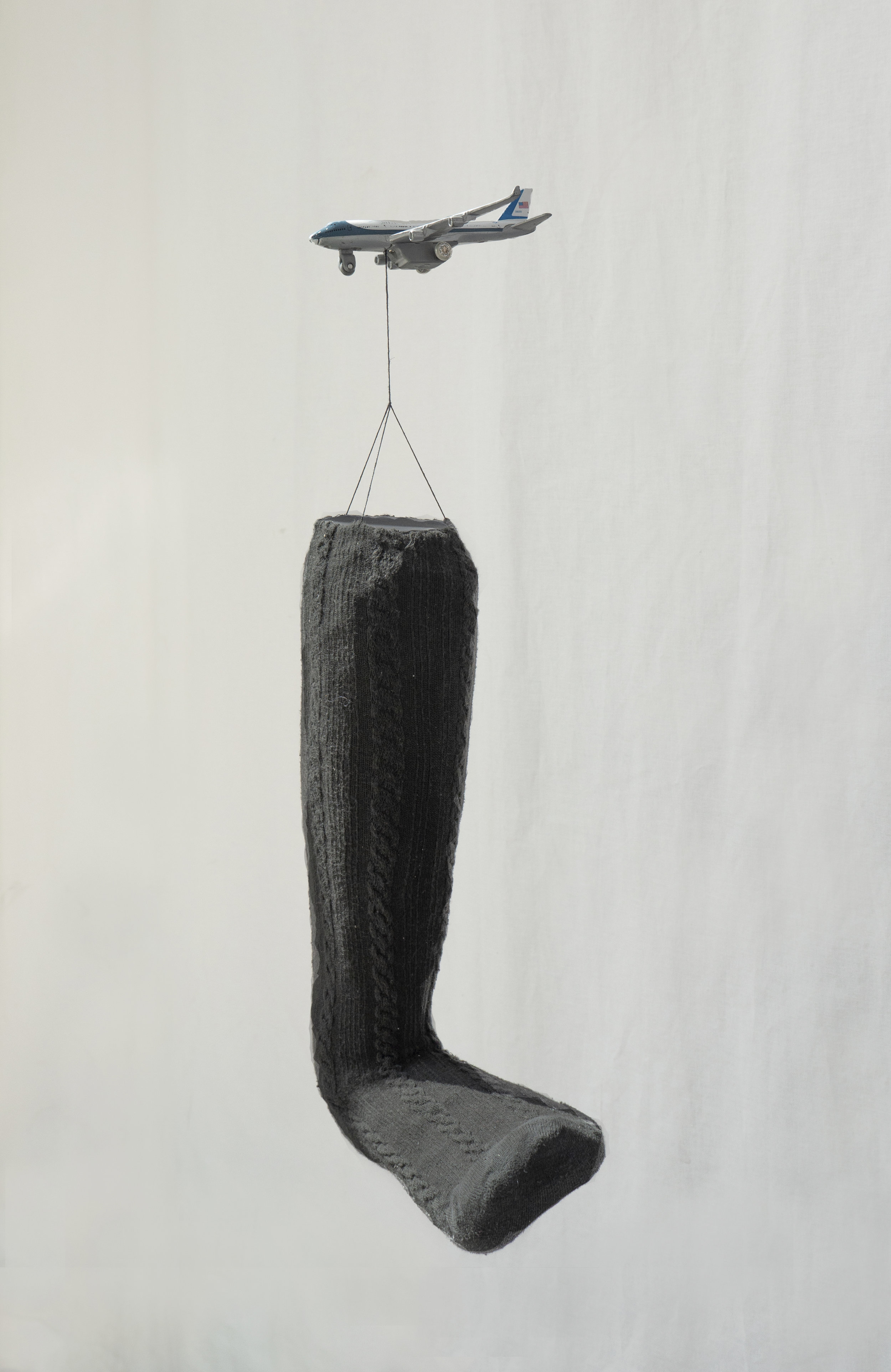 Nina Wiesnagrotzki,  Groovy Gait , 2018, Miniature airplane, string, sock, polystyrene