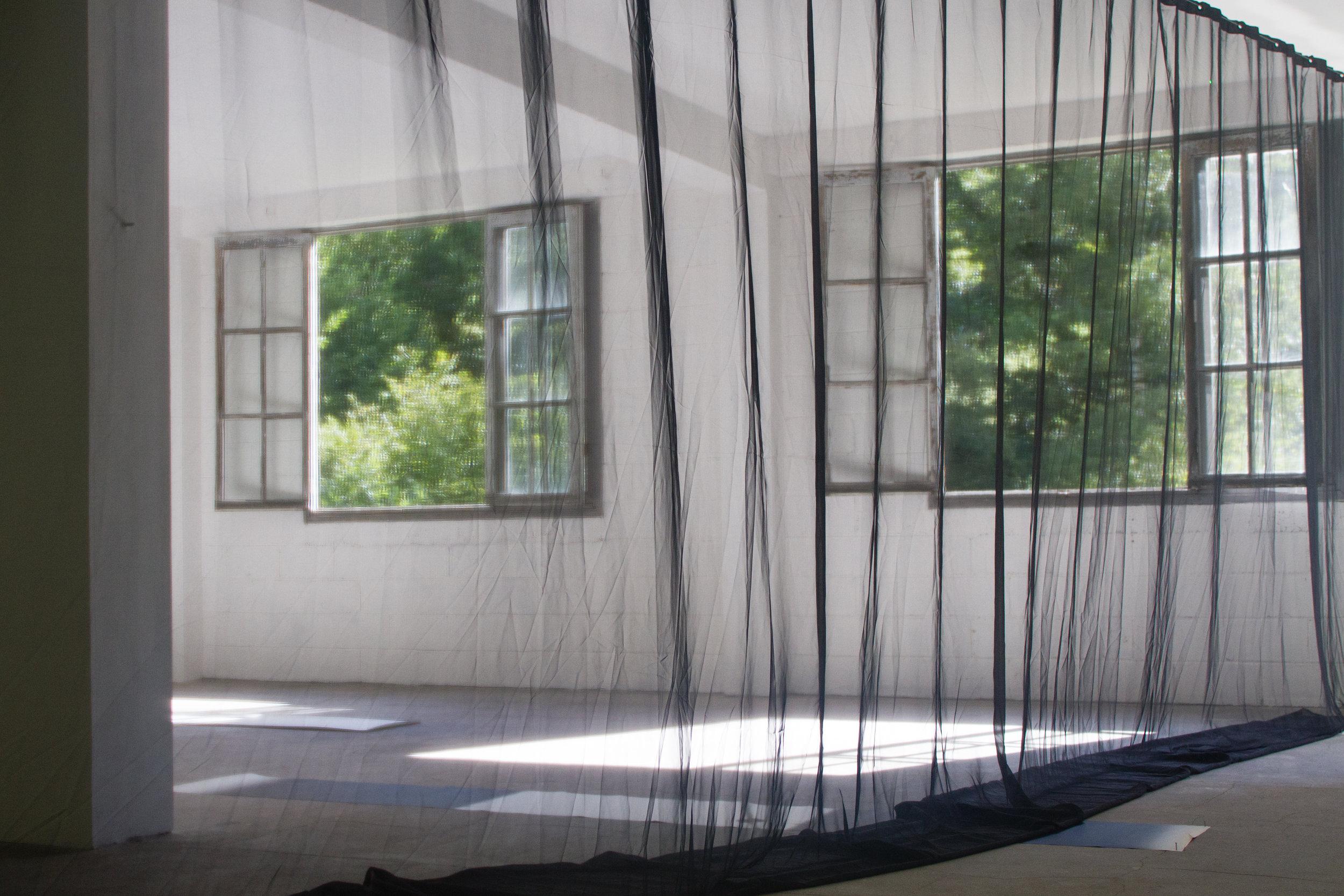 Jason Hendrik Hansma,  Éclisse , 2018, Chiffon curtaining and 200 milliwatt laser, 400 x 1000 cm into 288 x 940 cm