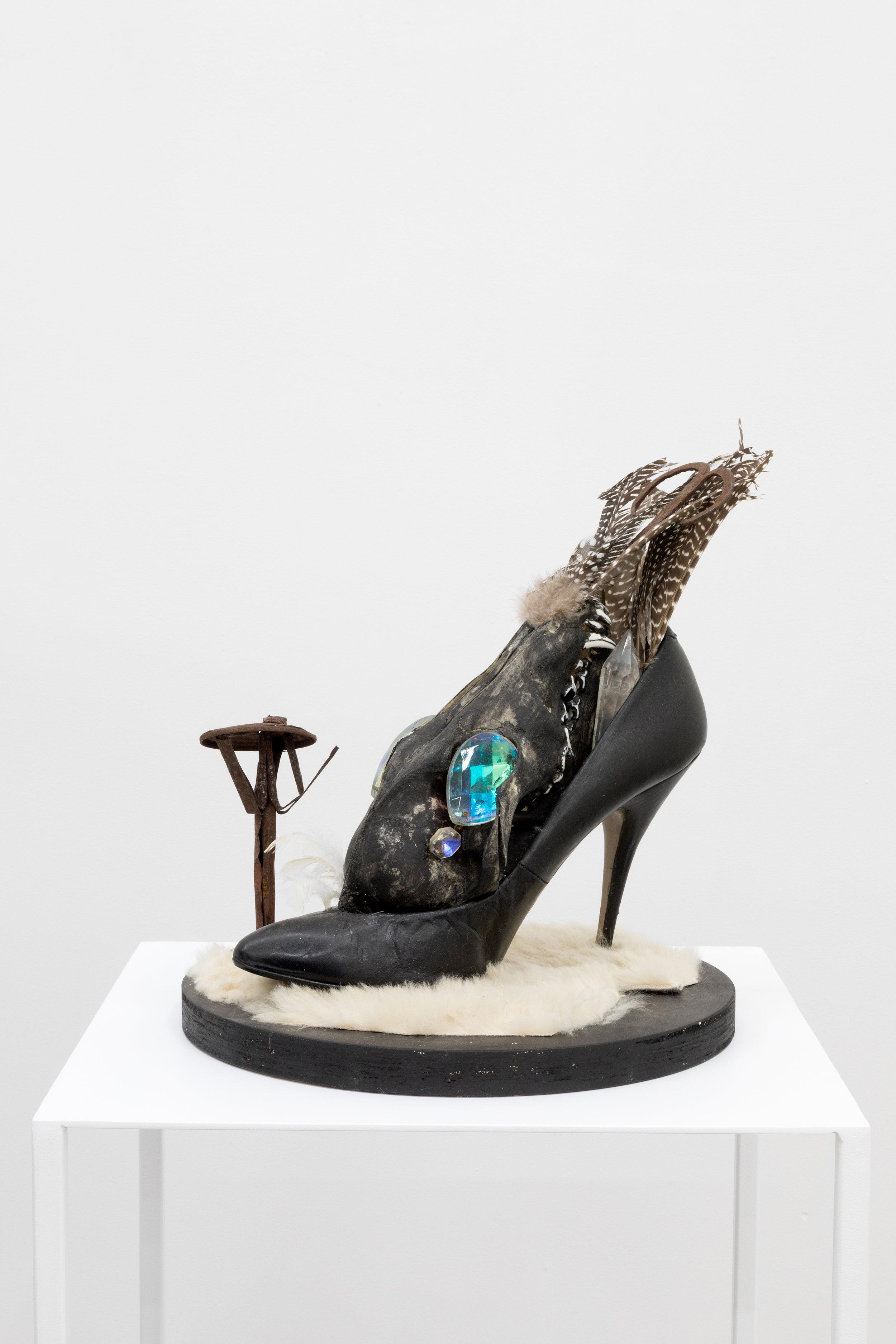 Genesis BREYER P-ORRIDGE,  Shoe Horn #6 , 2015, Horn, dominatrix shoe, Nepalese fabric-printing square, skull, feathers, Nepalese candle, gemstones, fur, 9 x 9 x 8 in