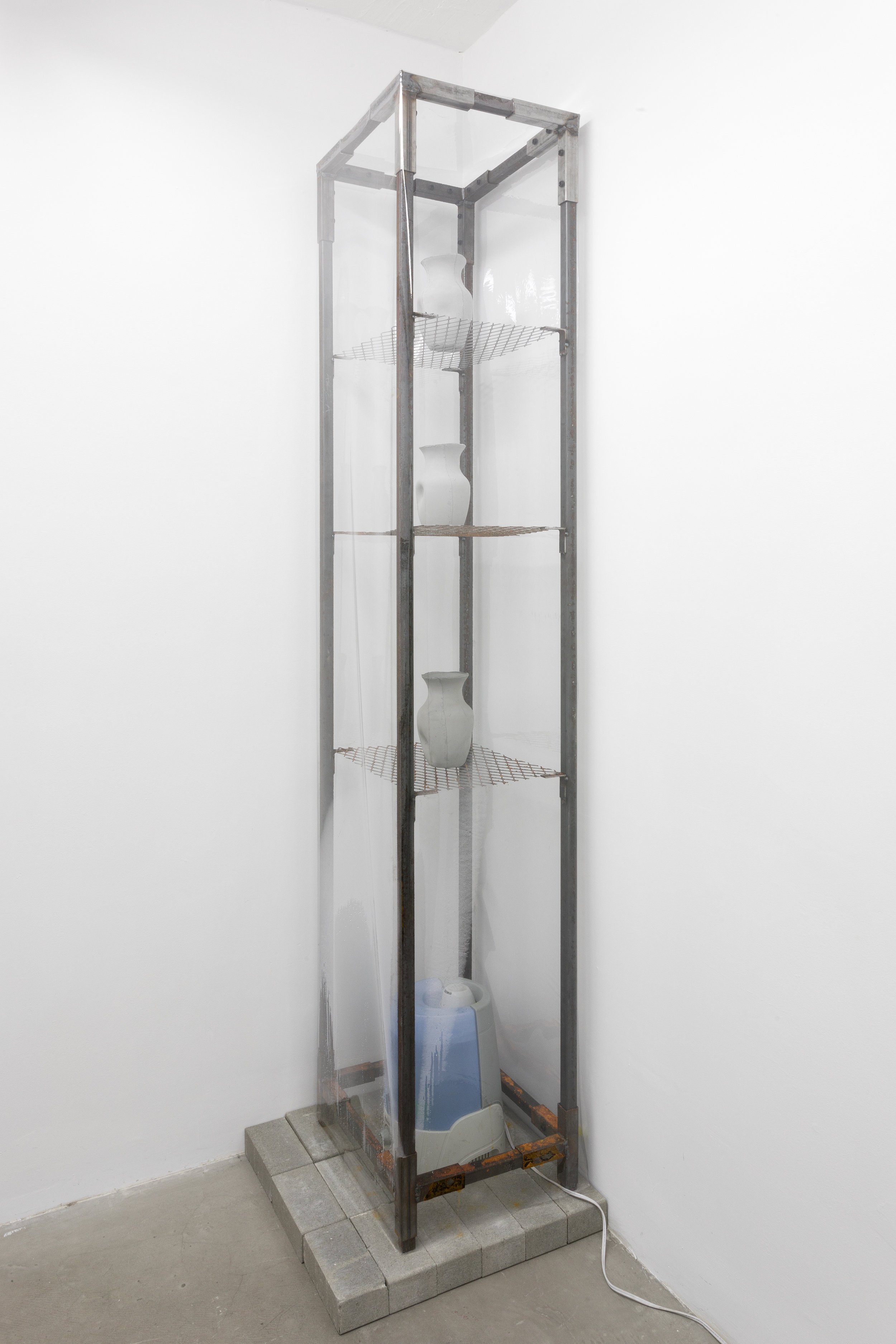 Azza El Siddique,  let me hear your sweat , 2018, Steel, unfired slip, humidifier, water, concrete bricks, Sandalya perfume oil, Dimensions variable