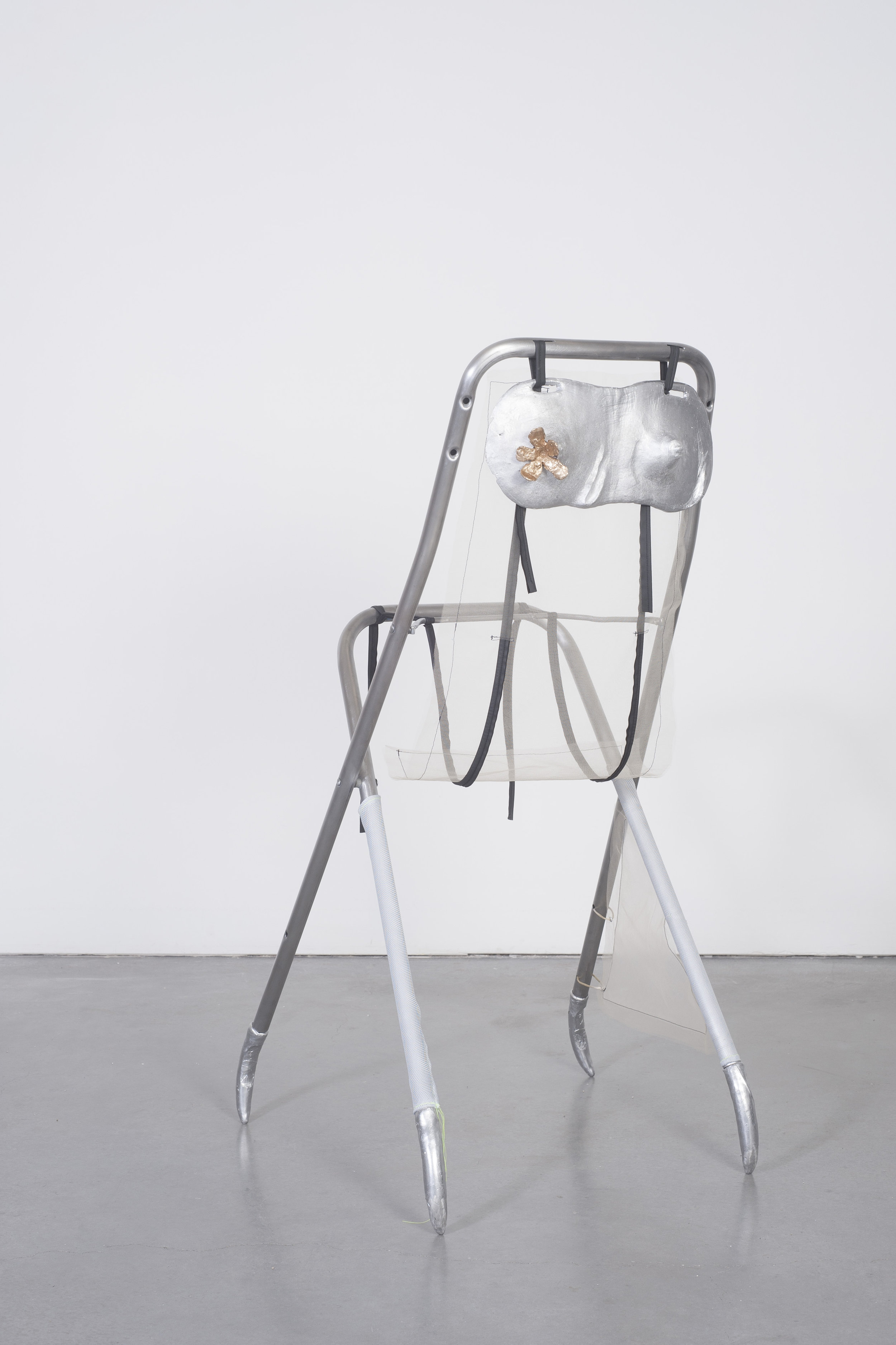 Ellie Hunter,  Trying it on , 2019, Cast aluminum, cast bronze, fabric, chair