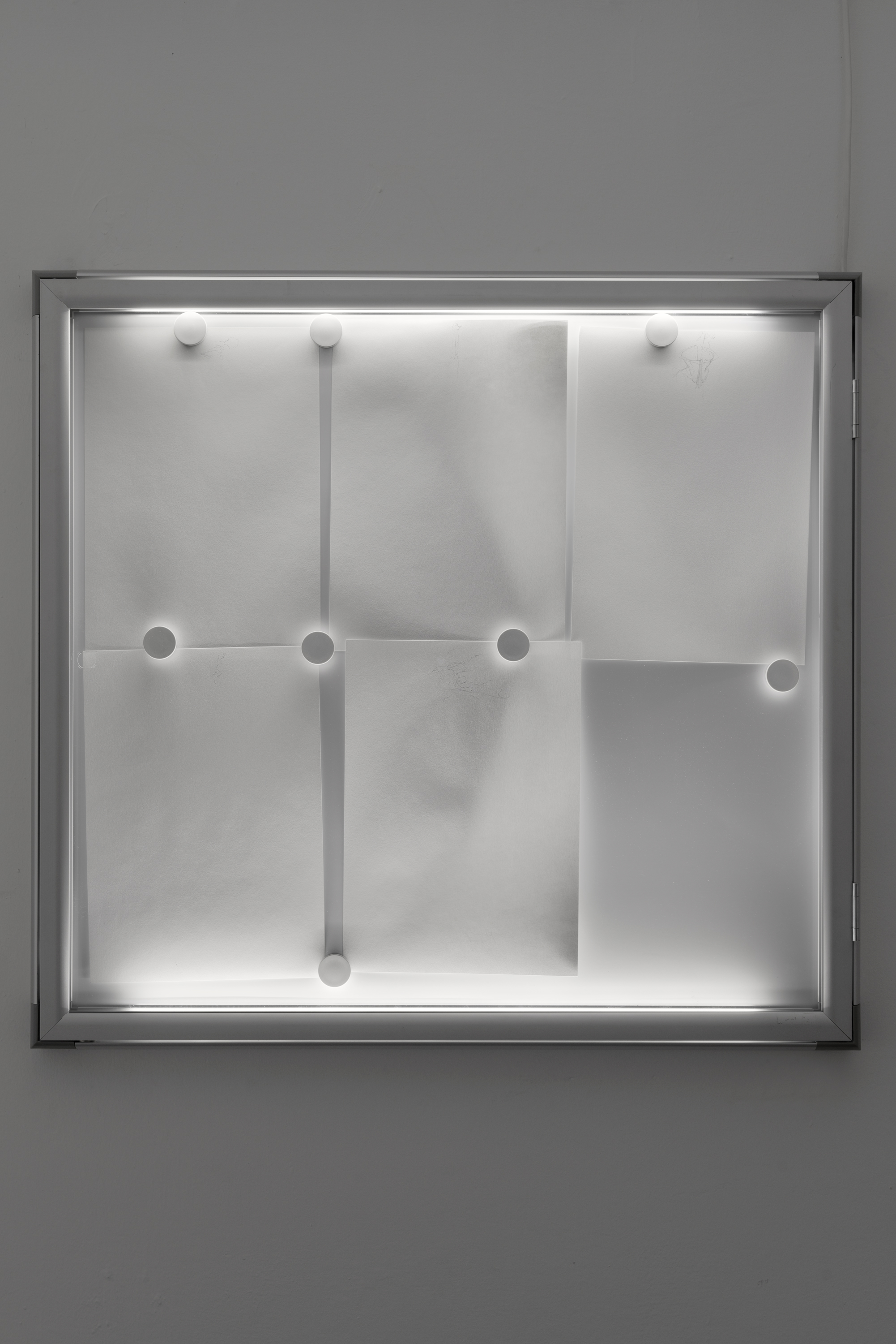 Philip Seibel,  Untitled , 2016-2019, pencil on A4 paper, magnets, display case, LED lights
