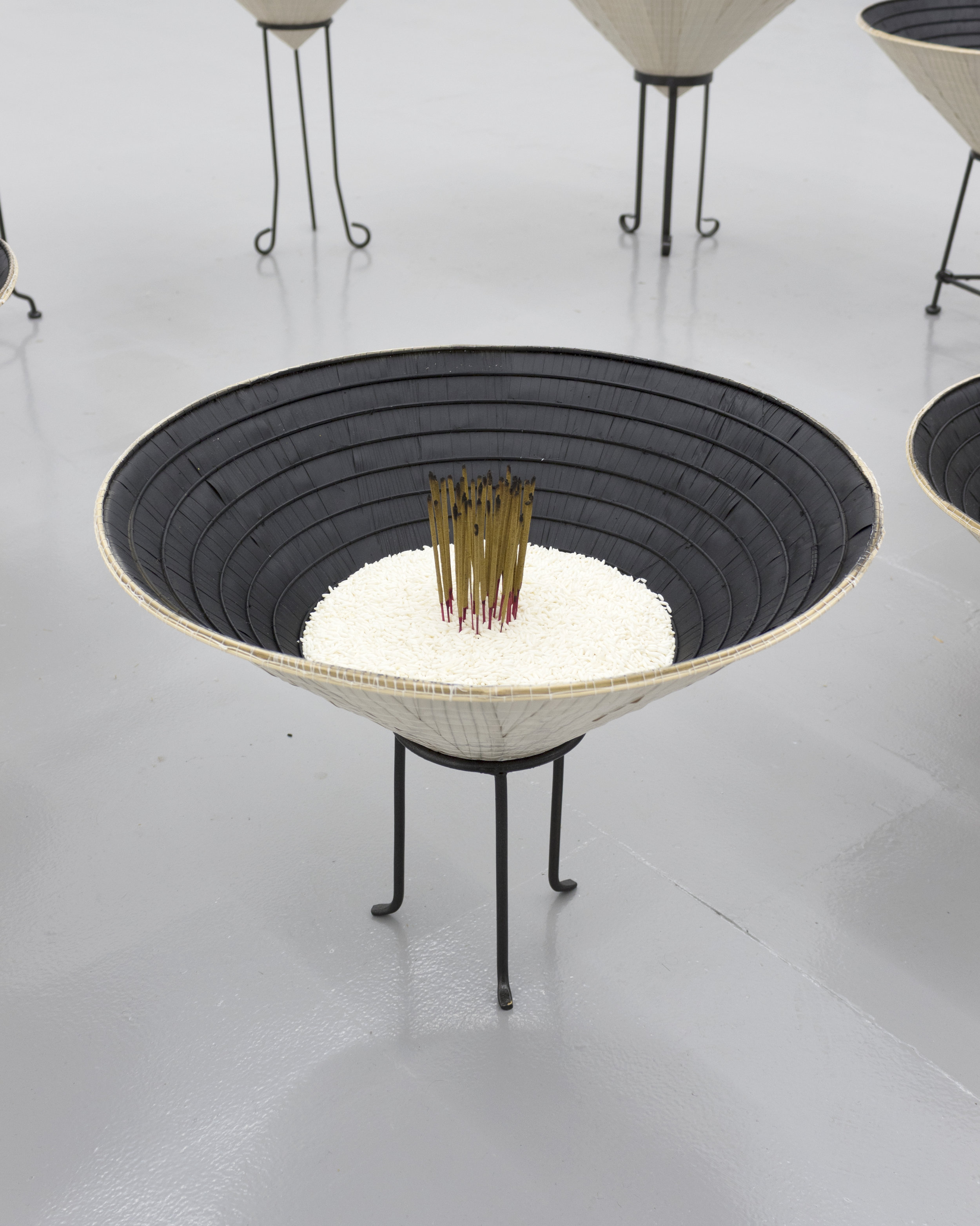 Millian Giang Lien Pham,  Reforge: 9 Phases (Nine),  2019. Conical hat, sweet rice, incense, metal stand