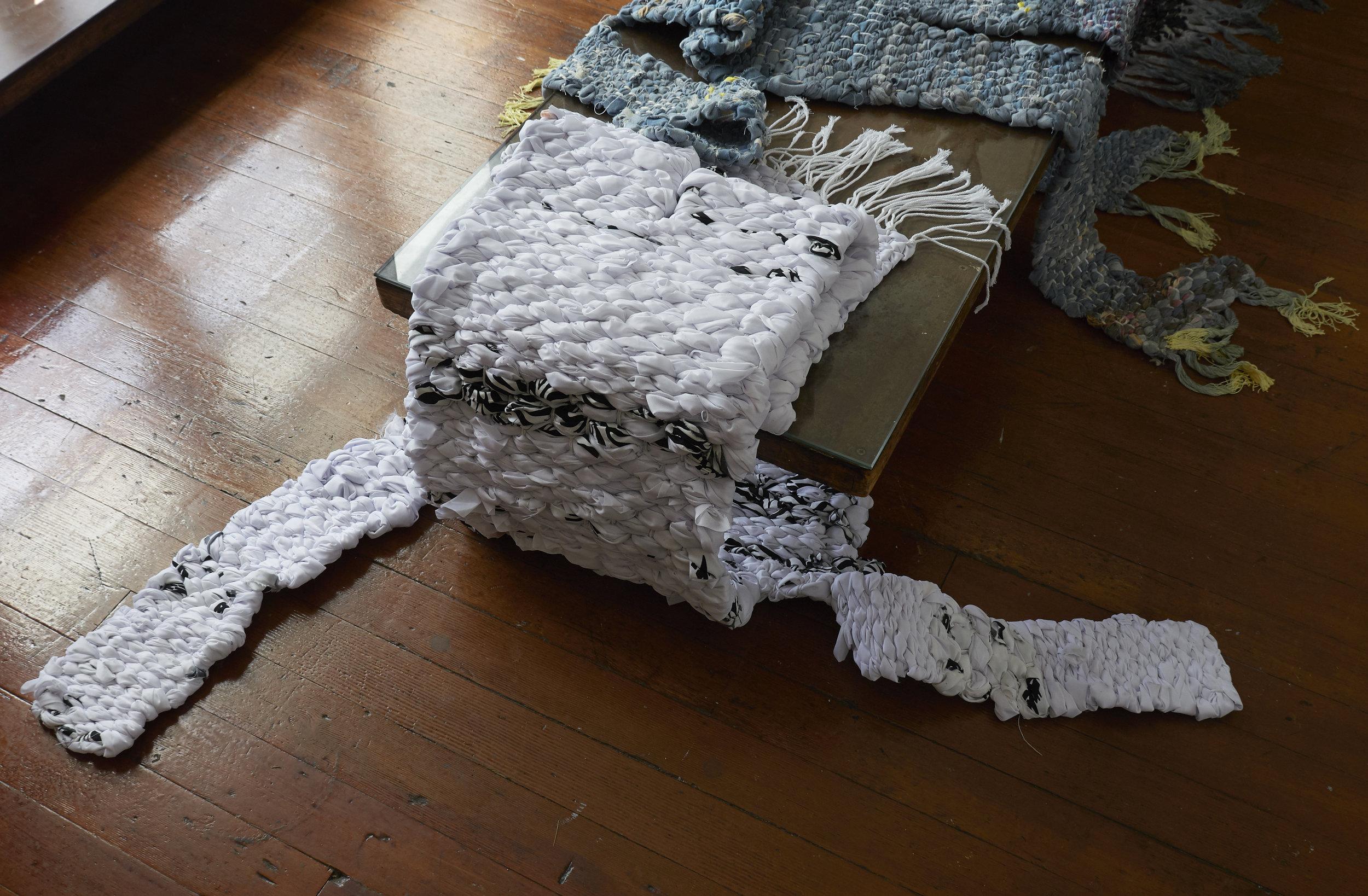 """Raichō"" 2019, Nina Wiesnagrotzki, hand-woven carpets, different fabrics and plastic foil, strings"