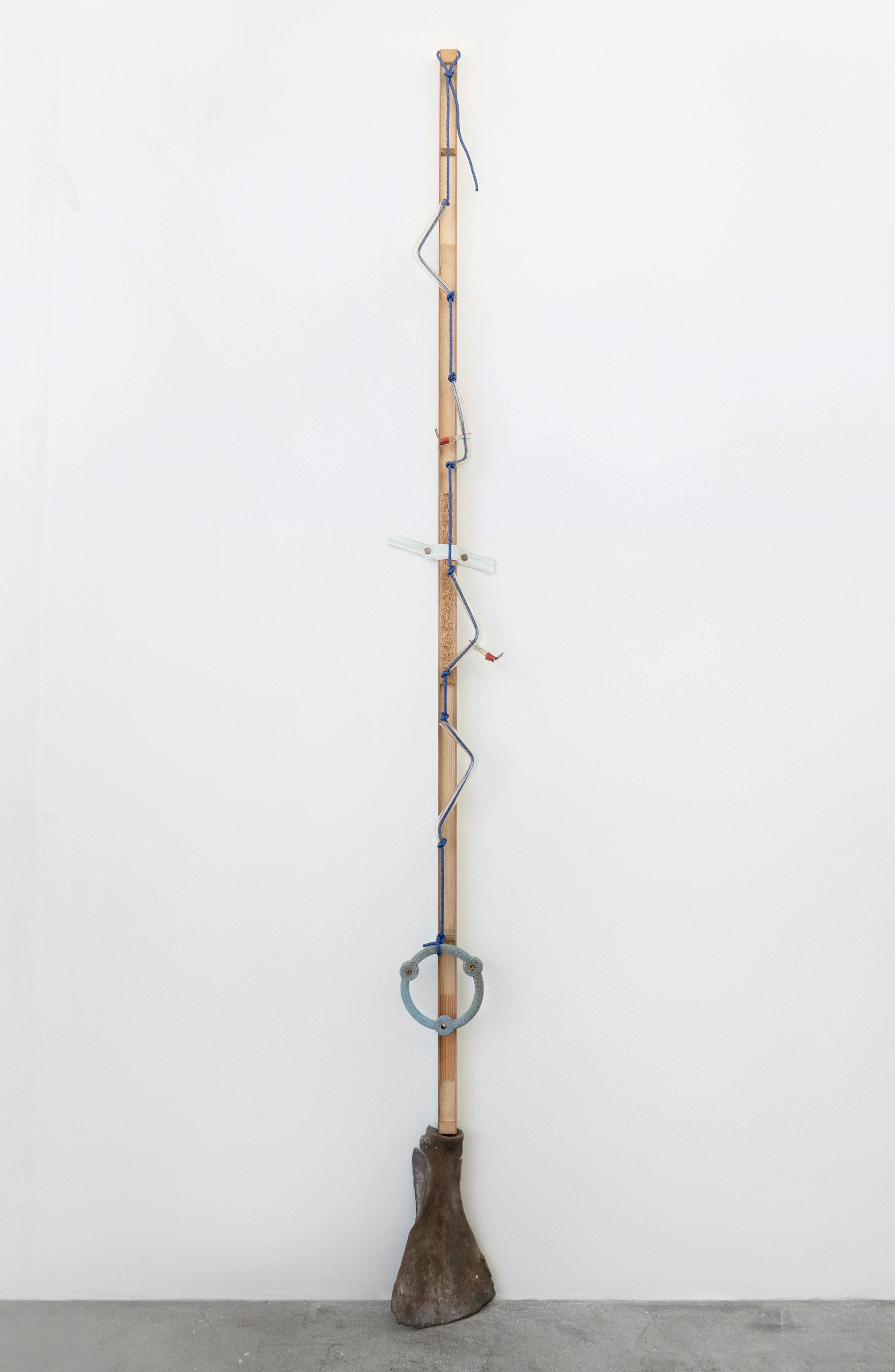 Matt Siegel,  E , 2018, Raw bronze, hollow core door, accessory cord, neon glass tubing (sourced: abandoned China Buffet, Evanston, WY), found object, fire, 92 x 8 x 5 in