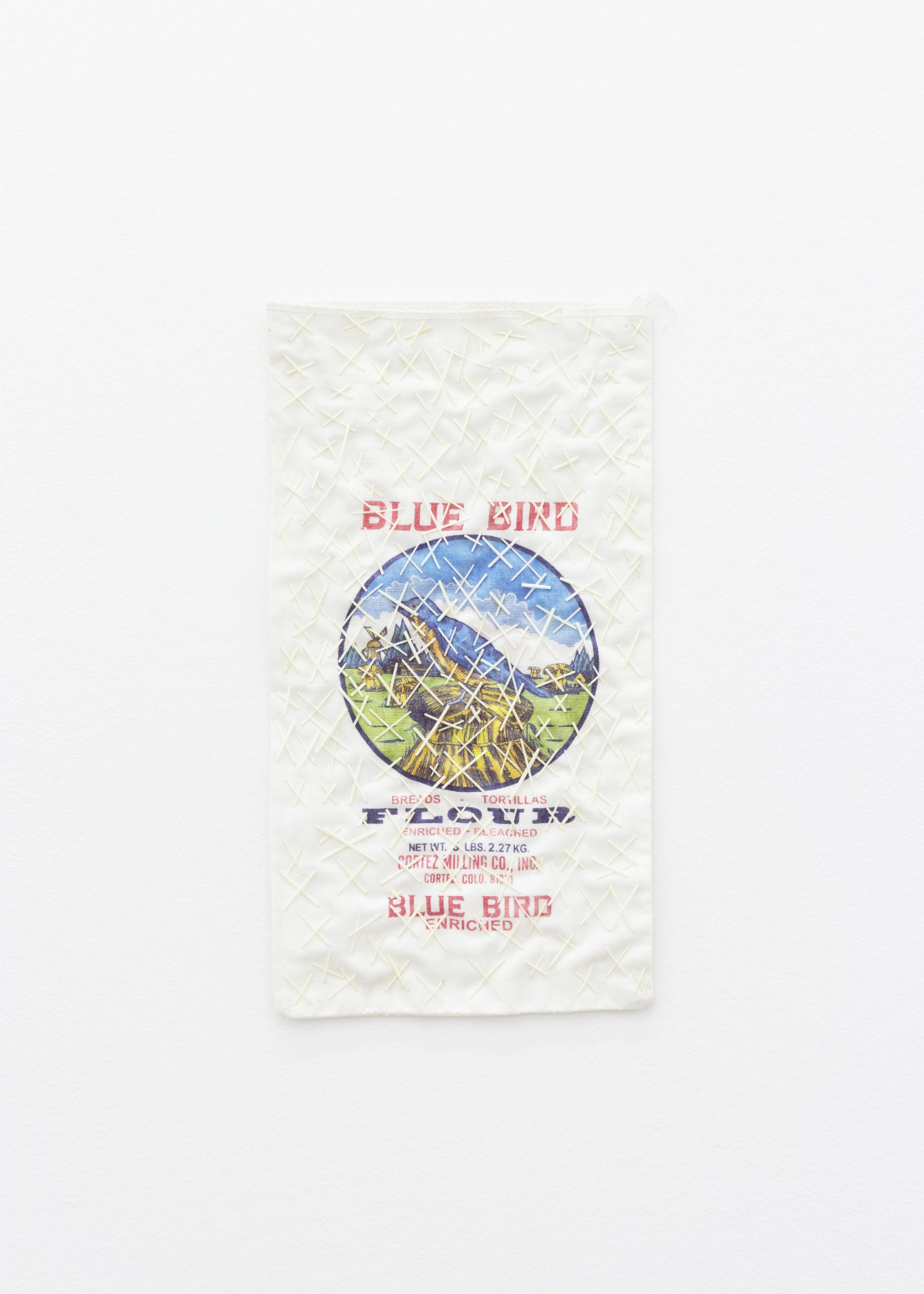 ... his x mark , 2019, Blue Bird Flour Bag, porcupine quills, thread, 15 x 8 in.