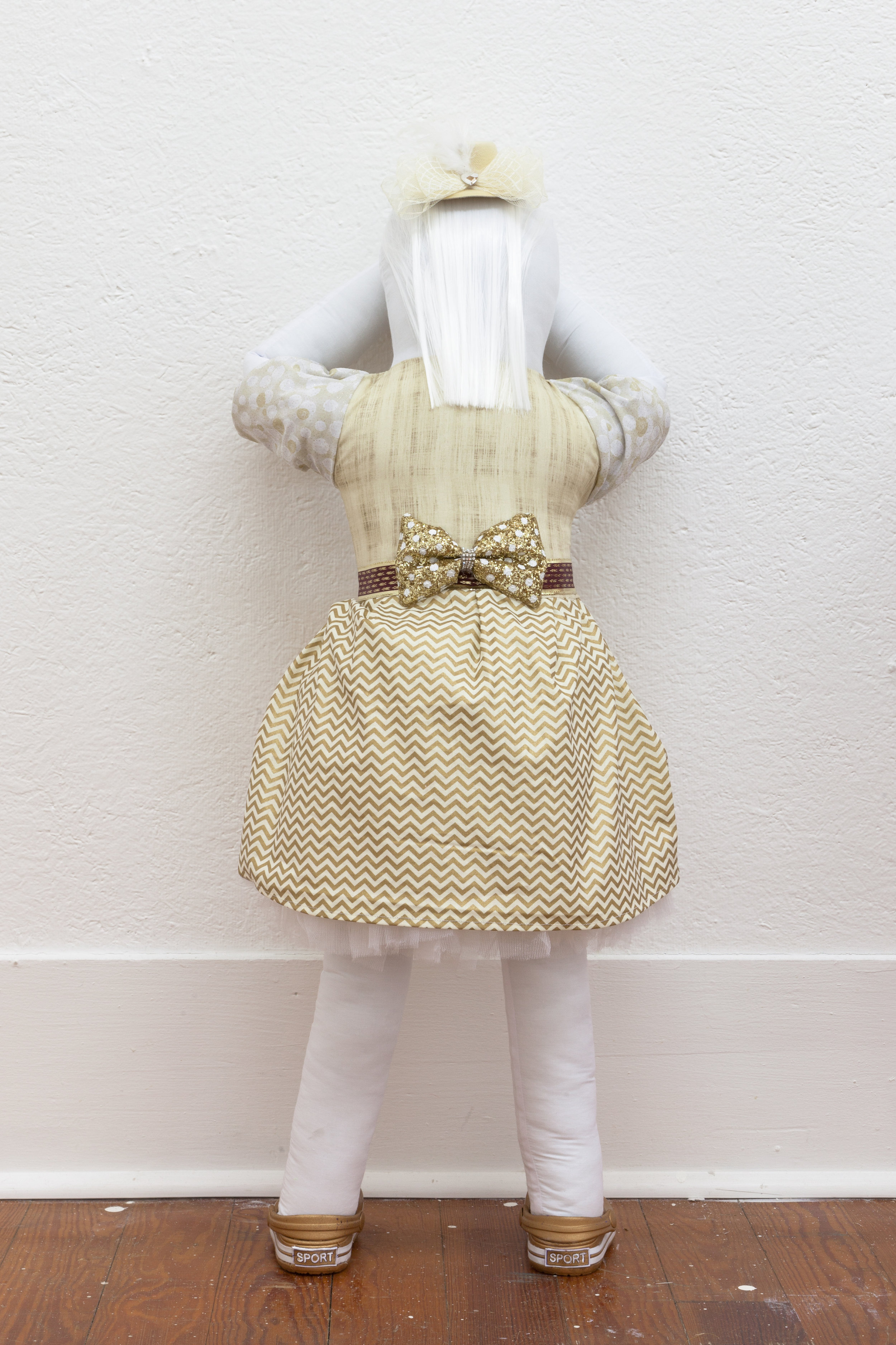 Abby Lloyd, Mary, 2019. Fabric, Poly-Fil, ribbon, hair extensions, found materials Approximately 36 x 14 inches