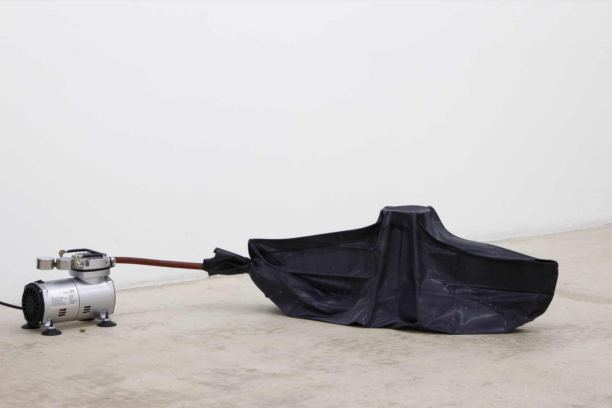 "Evita Vasiļjeva, ""Loat"", 2019, latex, steel, compressor, cable ties, plastic, cardboard"