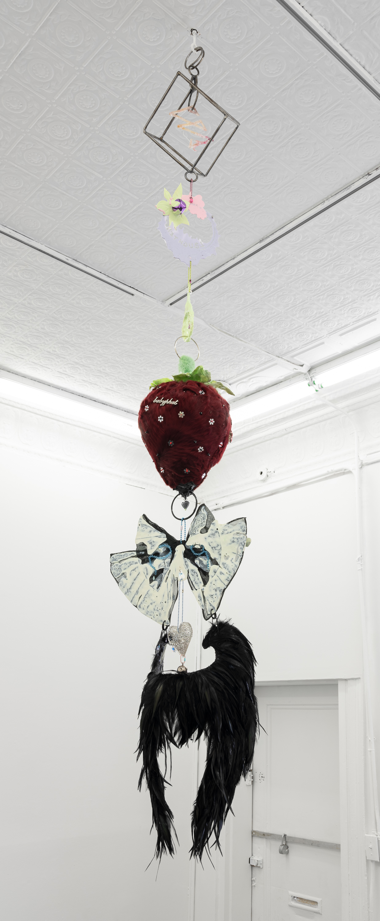 Izabelle New,  Keep Coming Back (patience),  2019 Steel Rod, Fine Silver, Resin, Assorted Hardware, Clover Flowers, Corn Husk Silks,Collected Charms, Rabbit Fur, Cock Feathers, Swarovski Crystals. A special thank you to Otis Denner-Kenny