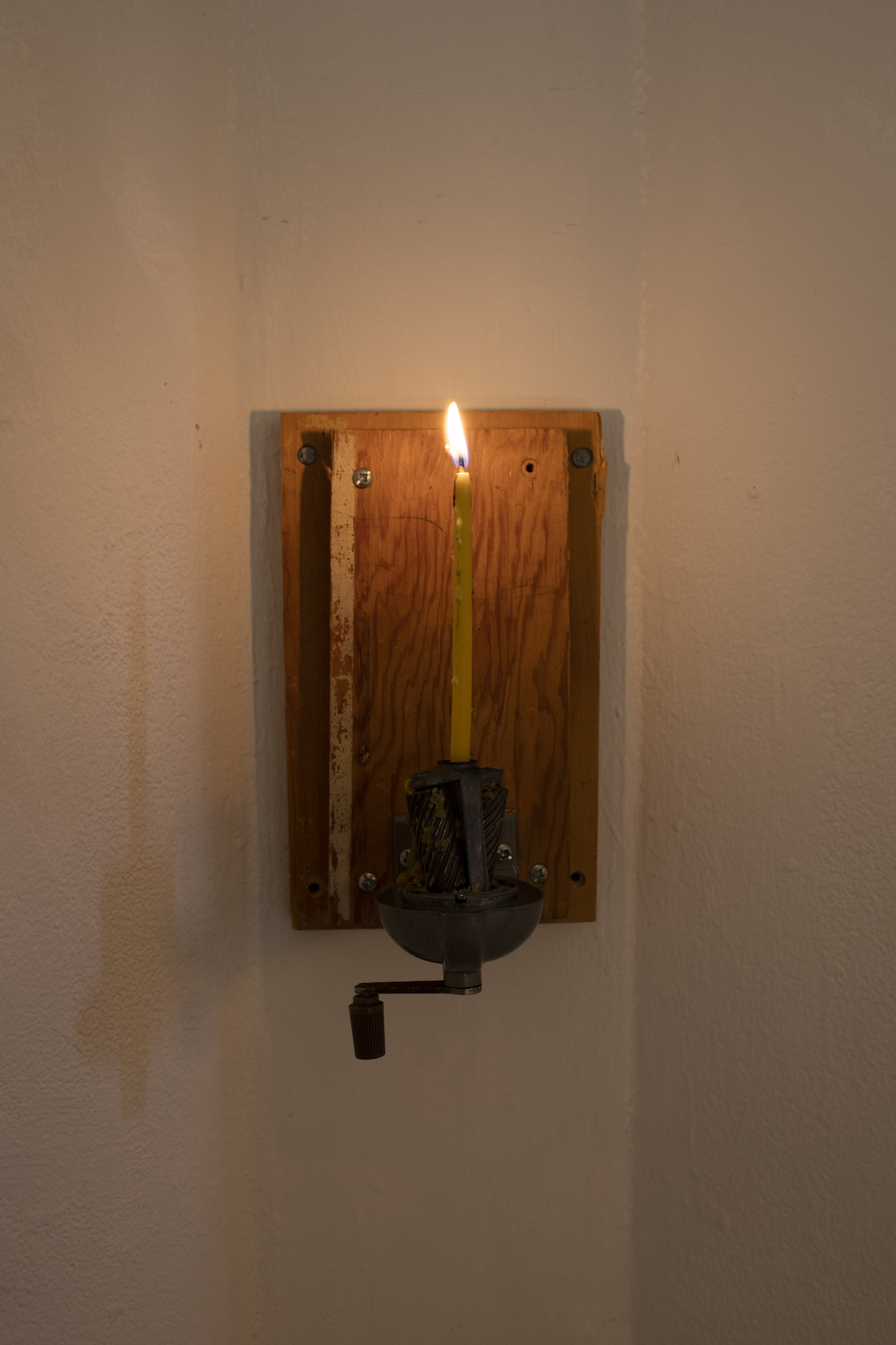 Untitled, 2019, pencil sharpener, beeswax candle by Maya Inglis, wood, 5.5 x 9 inch.