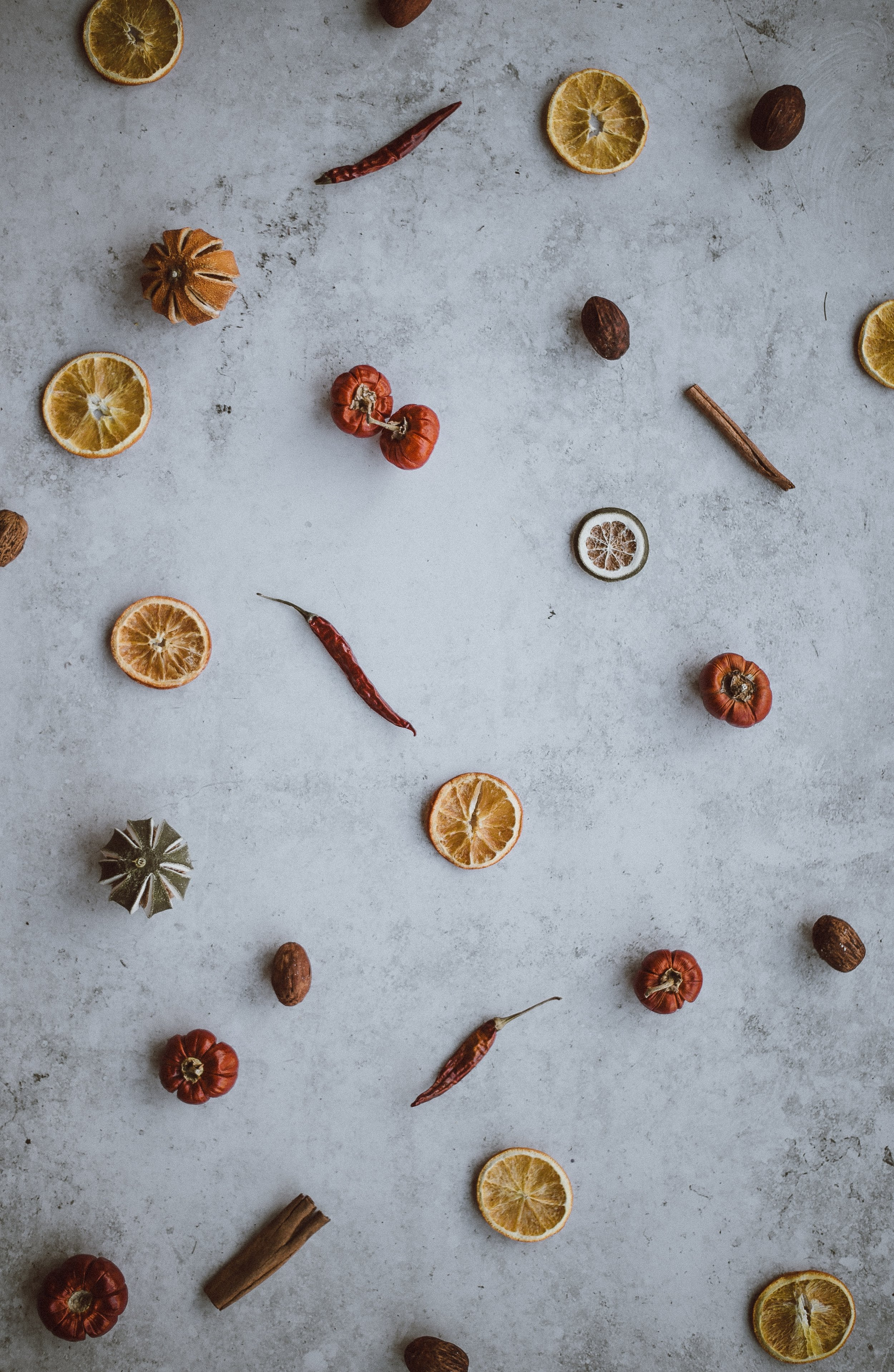 A photo of dehydrated citrus, peppers, tomatoes, and spices.