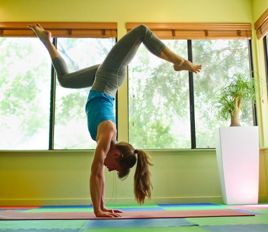 An arm balance pose demonstration.