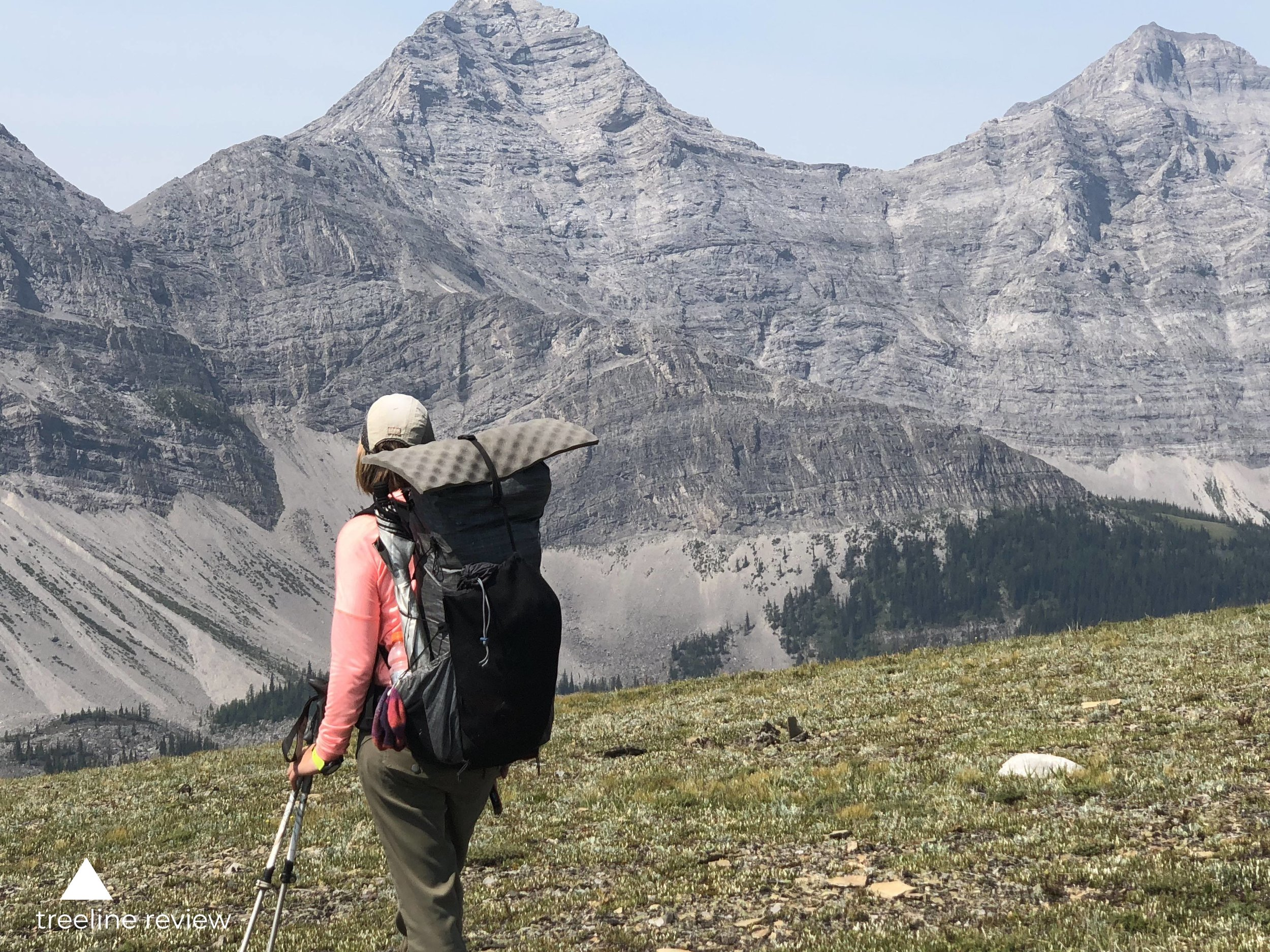 The Katabatic Liteskin in Jasper National Park on the Great Divide Trail. Note how the shock cord along the side secures the umbrella. The water bottle pocket on the right is holding a Smartwater Bottle with a Sawyer water filter on top. The strap on top holds down an foam sit pad.   Photo by Mike Unger.