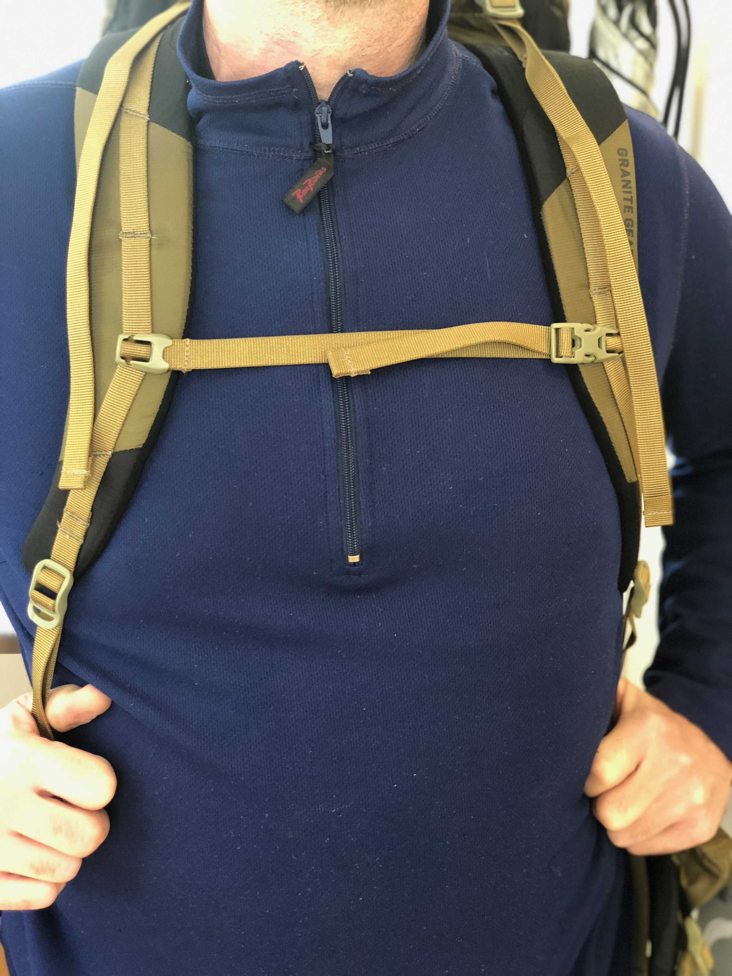 Tightening the sternum strap, shown here, helps relive pressure on your shoulders.