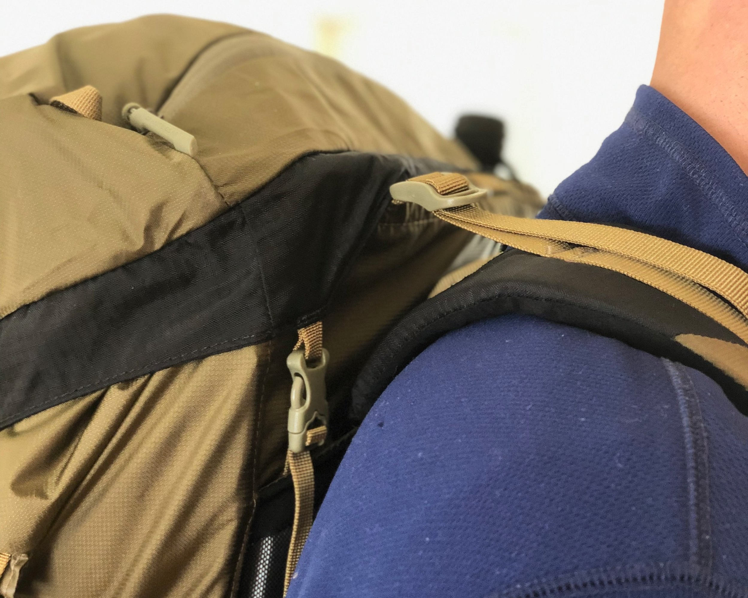 Load lifters on a backpack as viewed from the side.