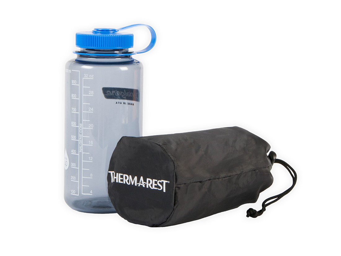The Therm-a-Rest NeoAir XLite packs down to the size of a one liter Nalgene water bottle.