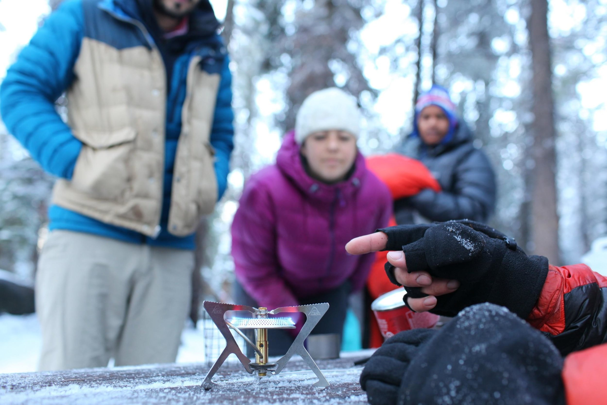 Consider a few questions about your backpacking style and where you're going before purchasing a backpacking stove.  Here, Off Trail On Track guide Duncan Cheung teaches students the finer points of how to light a stove.  Photo courtesy Duncan Cheung.