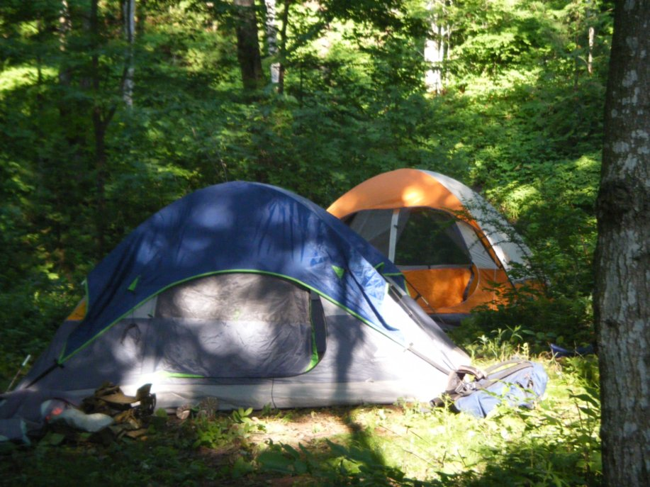 The Coleman Sundome camping tents are fine for beach and backyard tents, but lack of the durability and weatherproofness of the other tents we considered. Here, the author used the Sundome as part of an outdoor educational program that he led.   Photo courtesy Micah Leinbach.