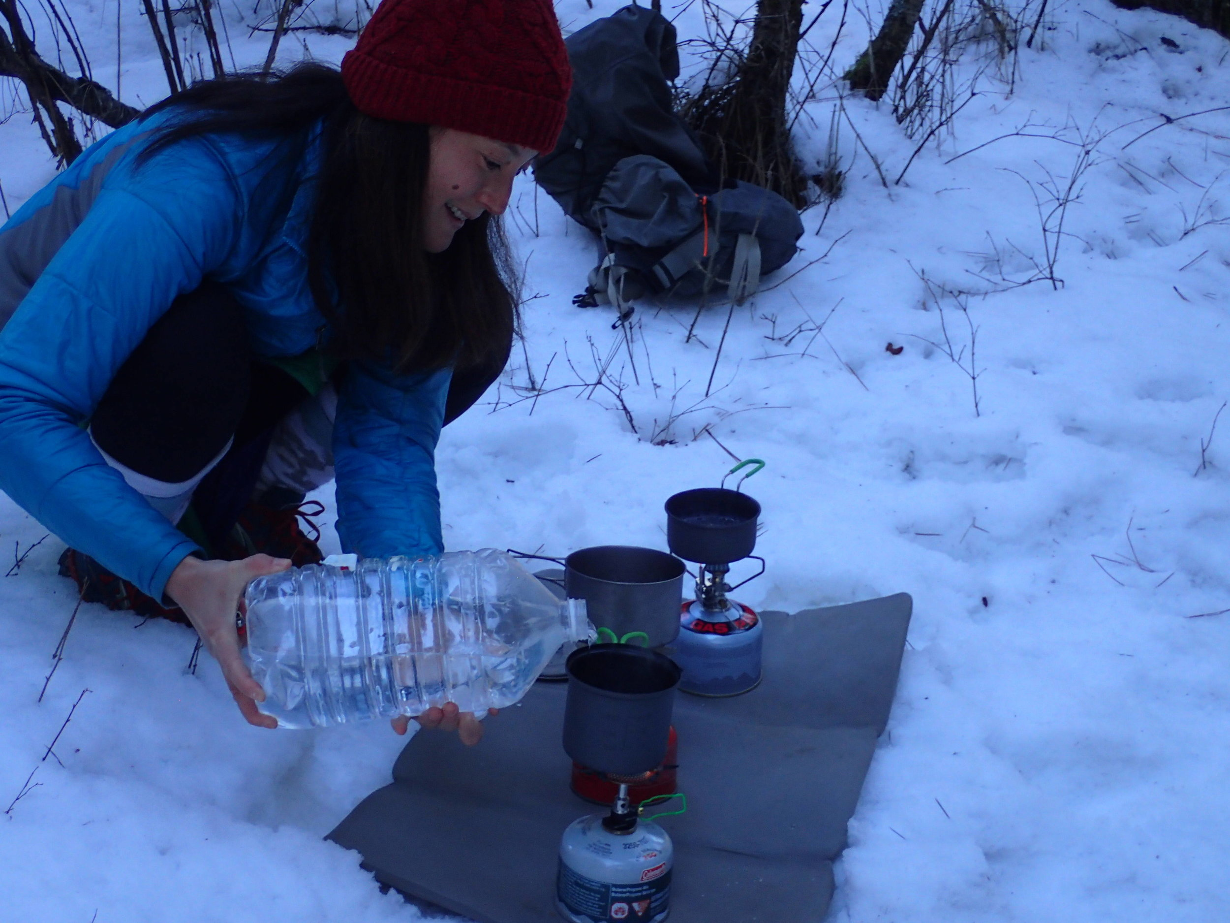 The author testing various cooksets and pots in Northern Idaho. Photo courtesy Liz Thomas.