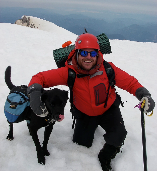 Karluk tested several of the packs we review. Here, he's on a mountaineering trip with his owner on top of Mt. Adams, Washington.   Photo courtesy Whitney LaRuffa.