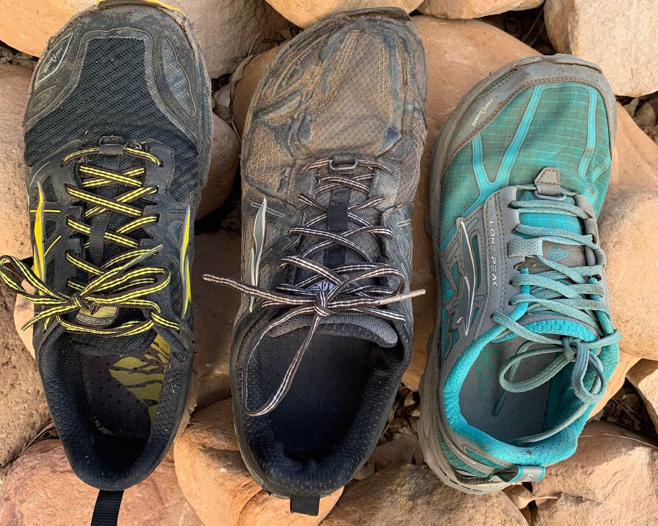 Compare the Altra Lone Peak 3.0 (left), Altra Lone Peak 3.5 (middle), and Altra Lone Peak 4.0 (right) after they've hiked the same miles, on the same trail, on the same days.   Photo courtesy Naomi Hudetz.