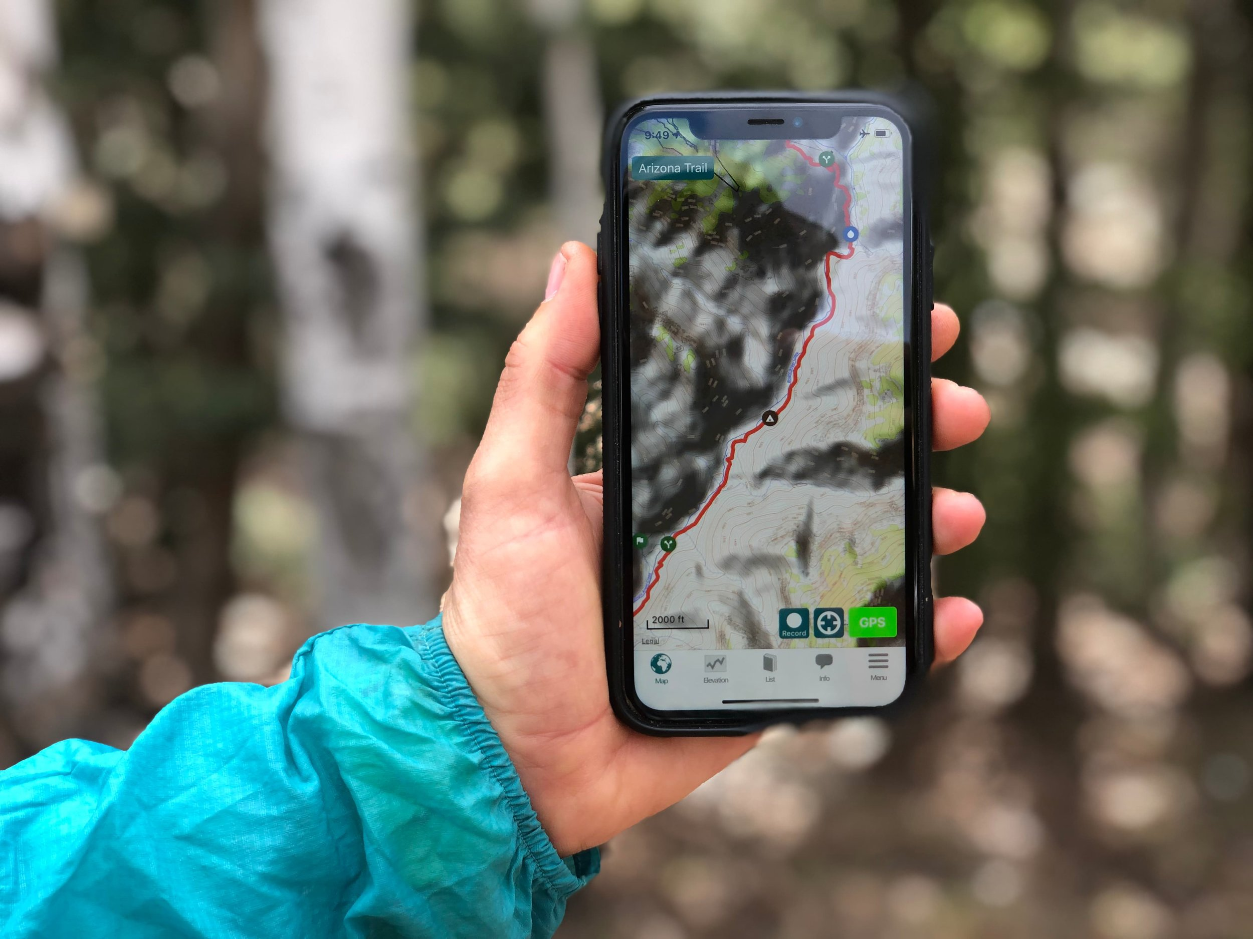 The iPhone has quickly become a useful gear item that most long distance hikers bring for taking photos, journaling, entertainment, and navigating on their adventures. Here it is shown with the Guthook AZT app. Photo courtesy Naomi Hudetz