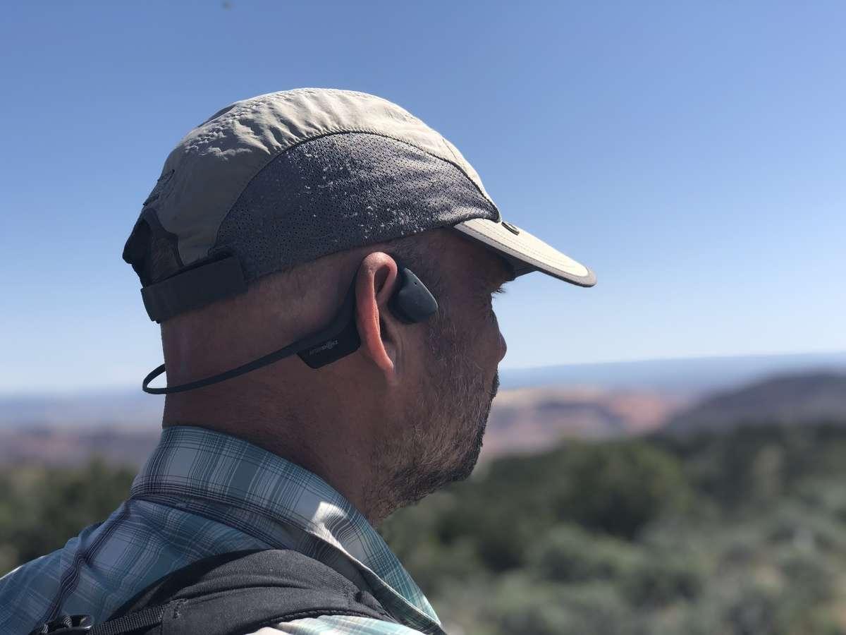 The Aftershokz Trekz Air wireless headphones on a tester.