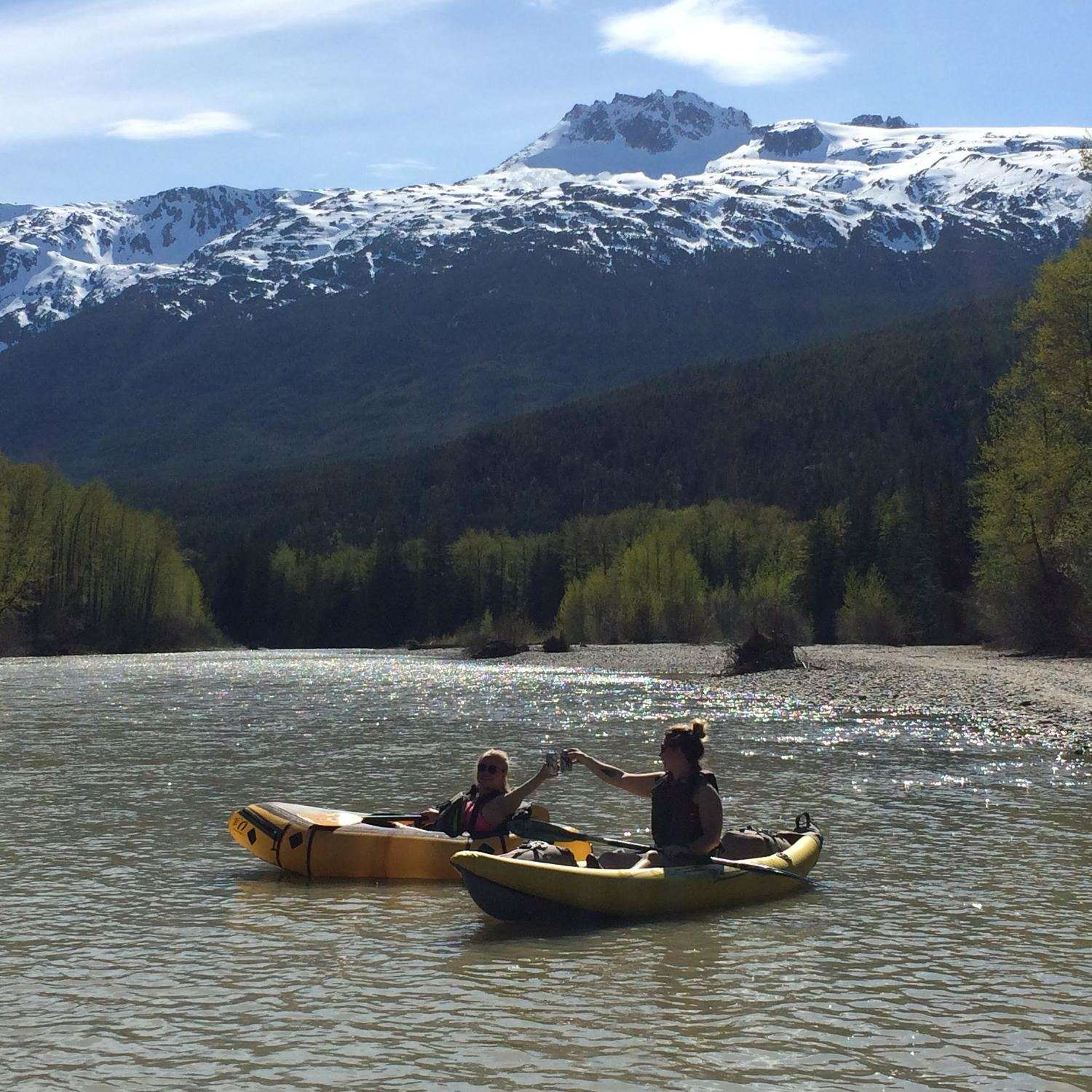 Sarah (left) wearing the Astral Layla PFD, and Josette (right) wearing the NRS Vapor on the Taiya River, Dyea, Alaska.