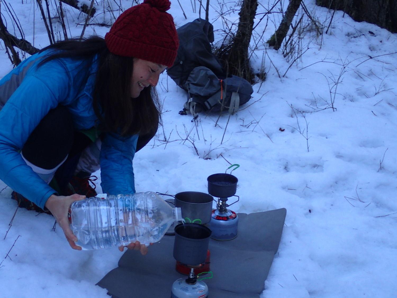 The author testing the Optimus Crux Lite and Snow Peak GigaPower on snow.   Photo courtesy Liz Thomas